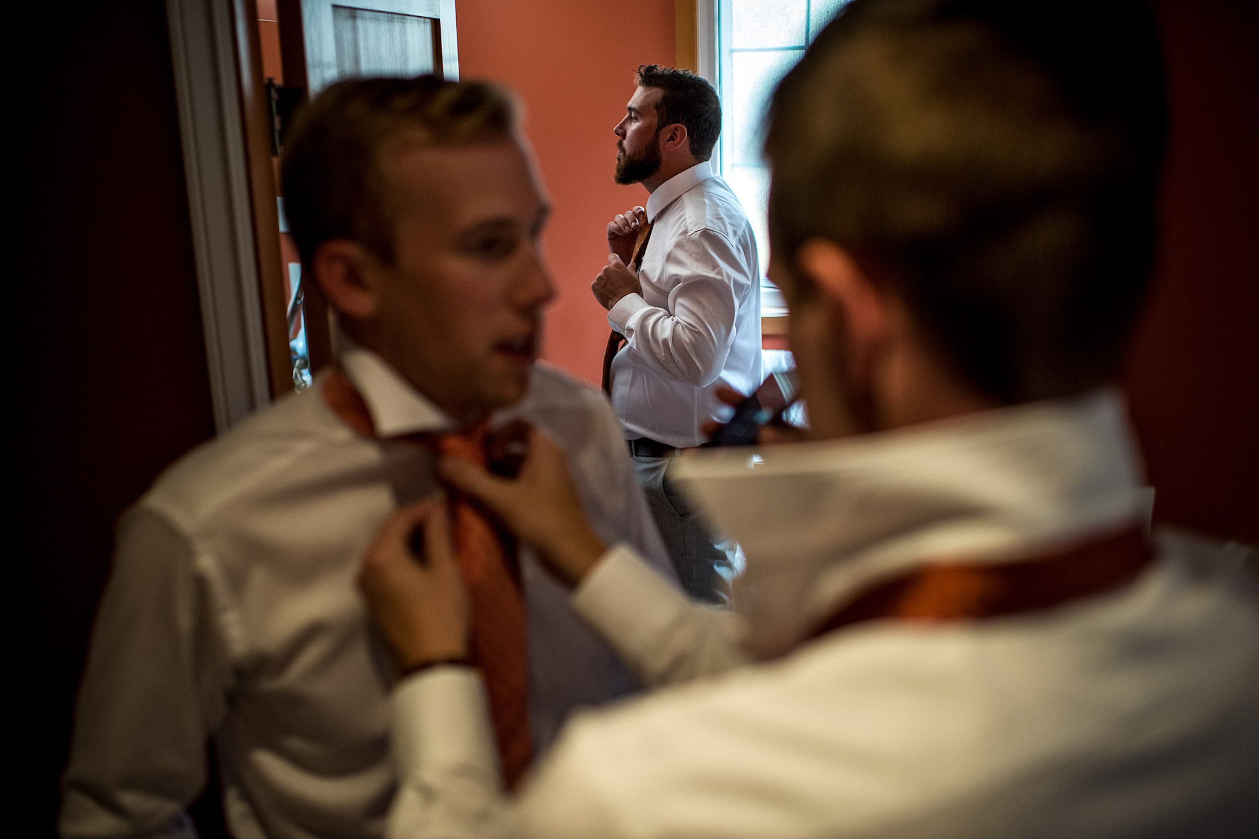 a room of groomsmen getting ready - Qualicum Wedding Photographer