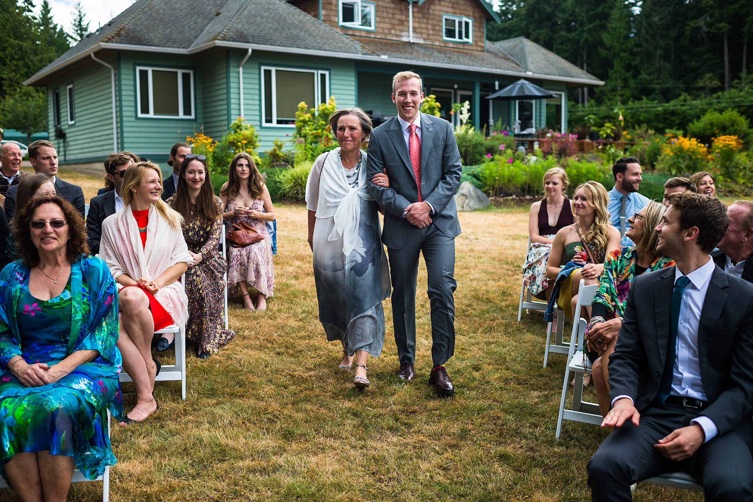 A groom walking his mom down the aisle at a backyard wedding in BC - Qualicum Wedding Photographer