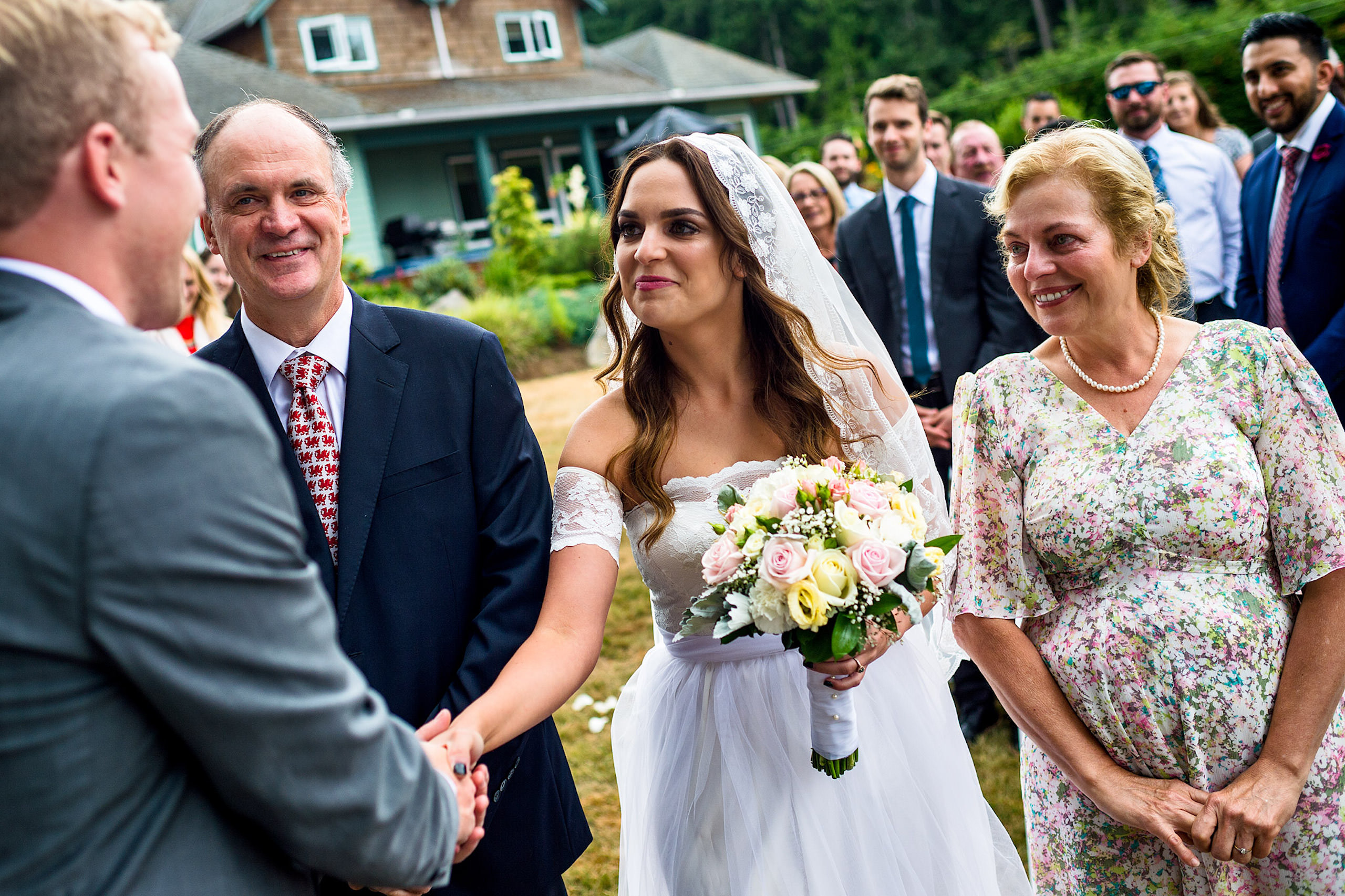 A bride seeing her groom for the first time at a backyard wedding in BC - Qualicum Wedding Photographer