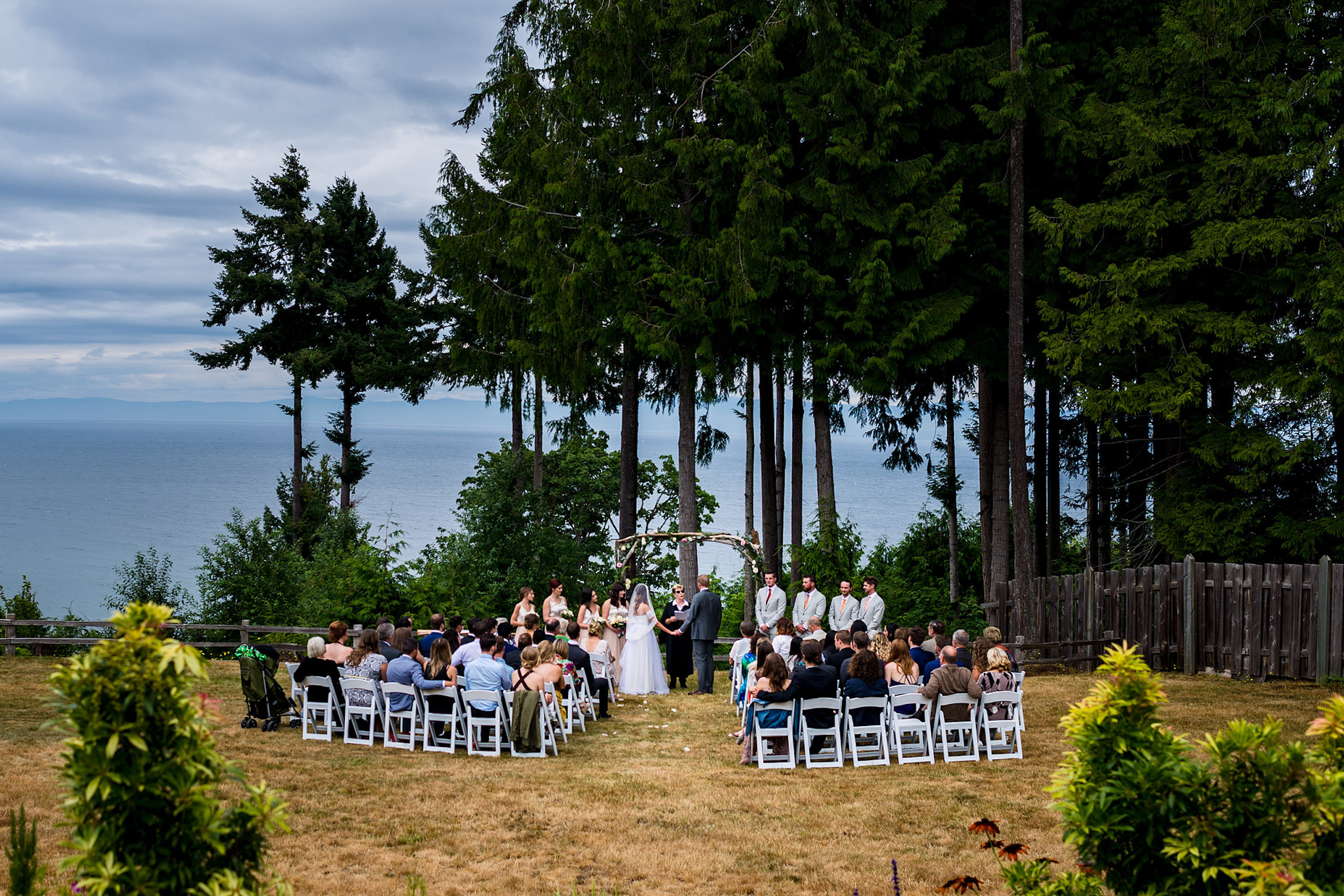 A wide angle photograph of a backyard wedding in BC - Qualicum Wedding Photographer