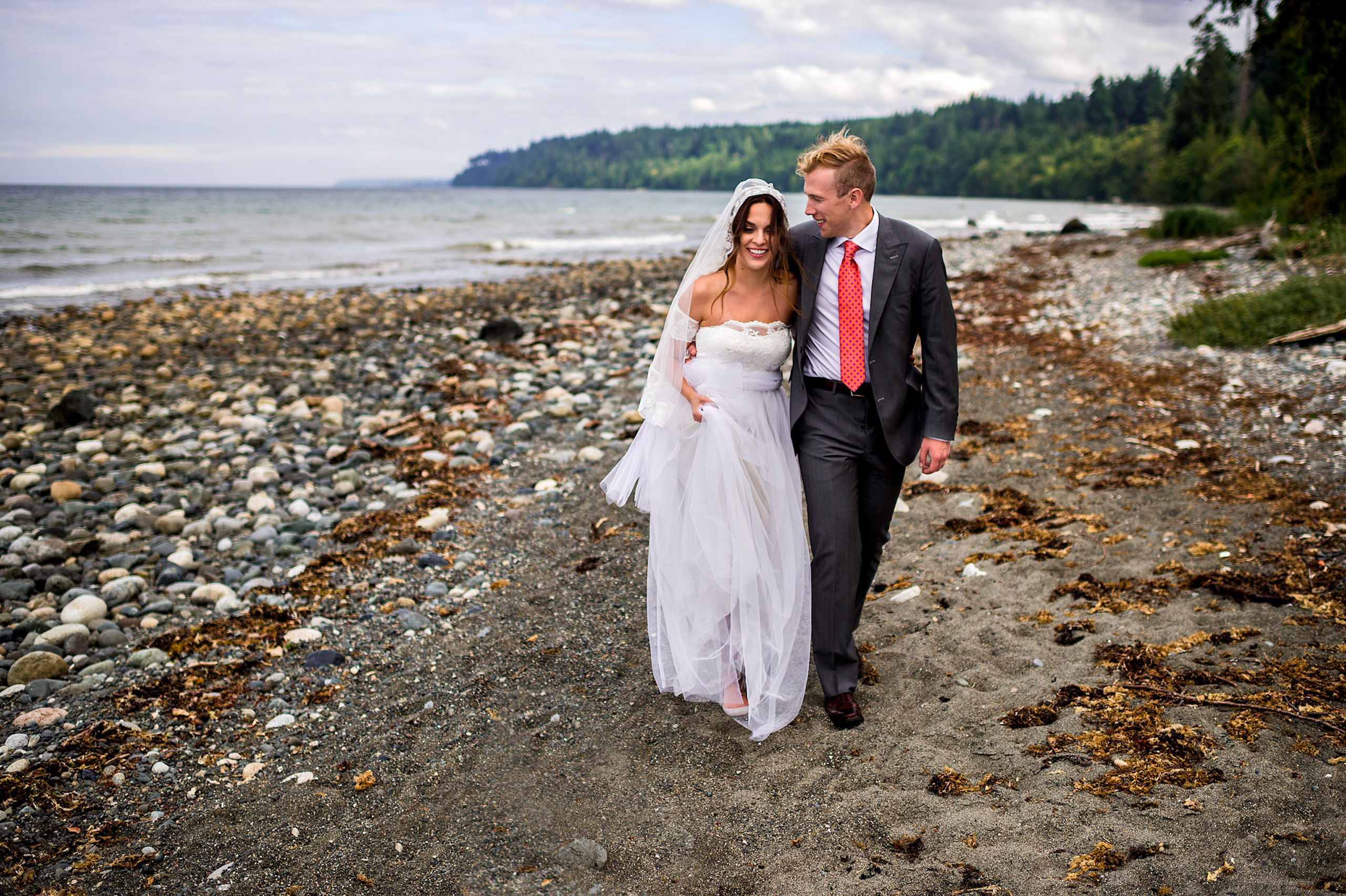 A bride and groom walking down a beach in BC - Qualicum Wedding Photographer