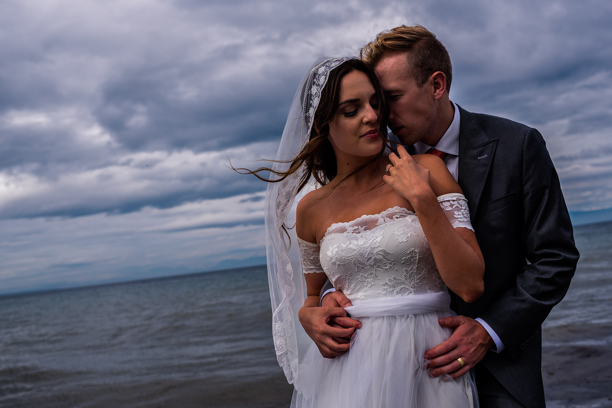 A close up of a bride and groom in a portrait infront of the ocean - Qualicum Wedding Photographer