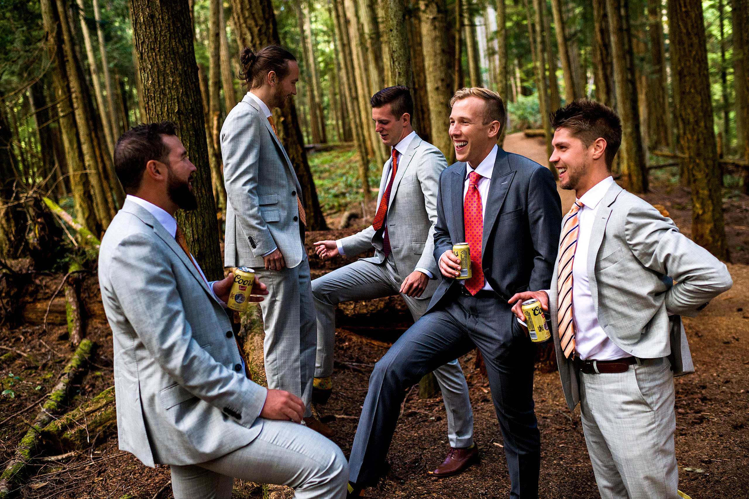 Groomen standing in the forest drinking beers in BC - Qualicum Wedding Photographer