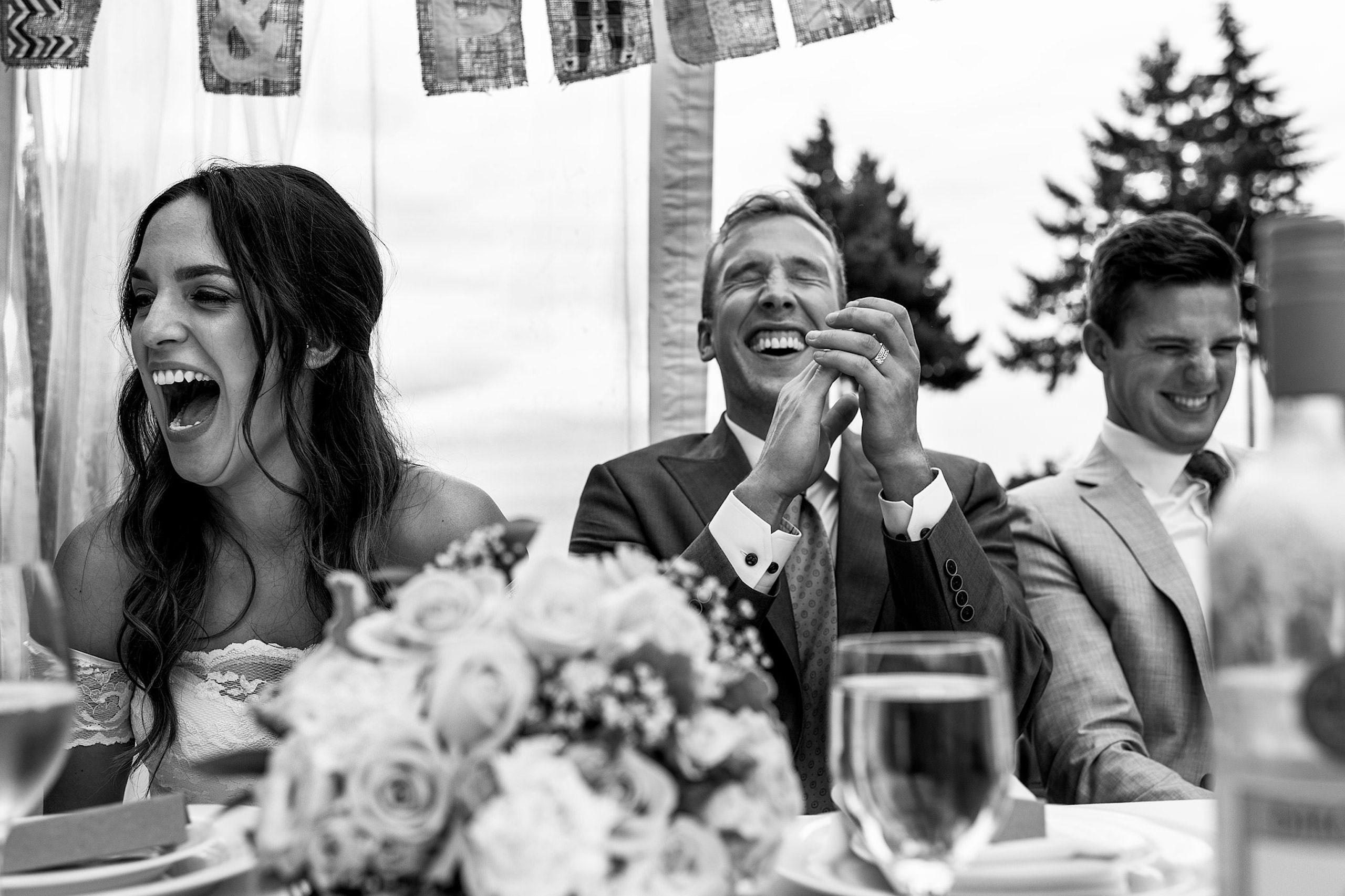 A groom laughing at the best mans speech in BC - Qualicum Wedding Photographer
