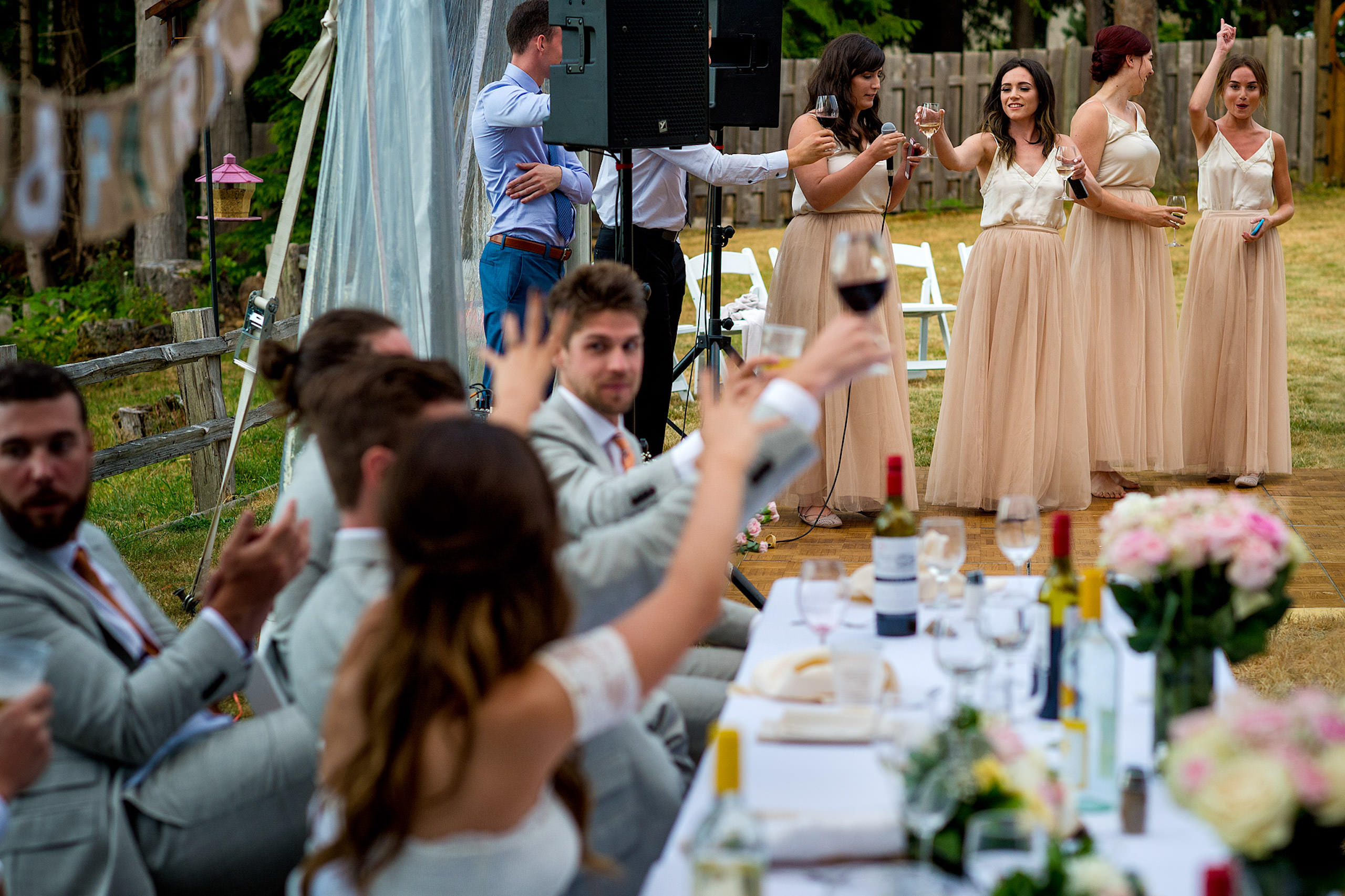 Bridesmaids giving a speech at a backyard wedding in BC - Qualicum Wedding Photographer