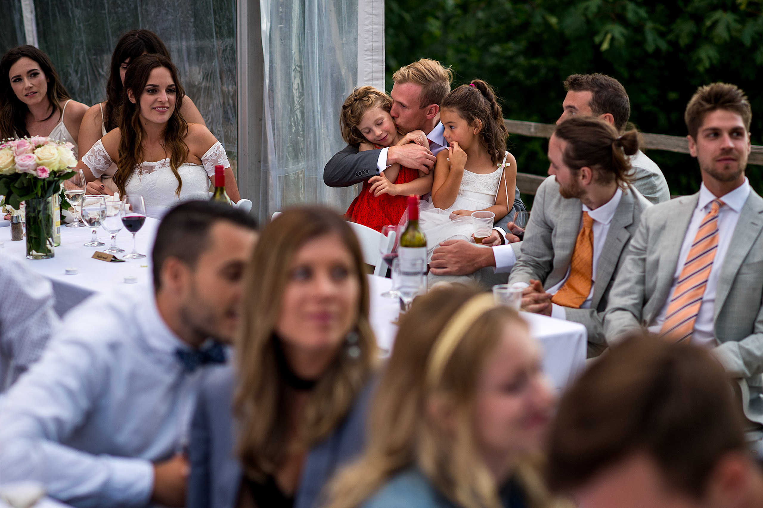 A groom kissing his niece at his wedding reception - Qualicum Wedding Photographer