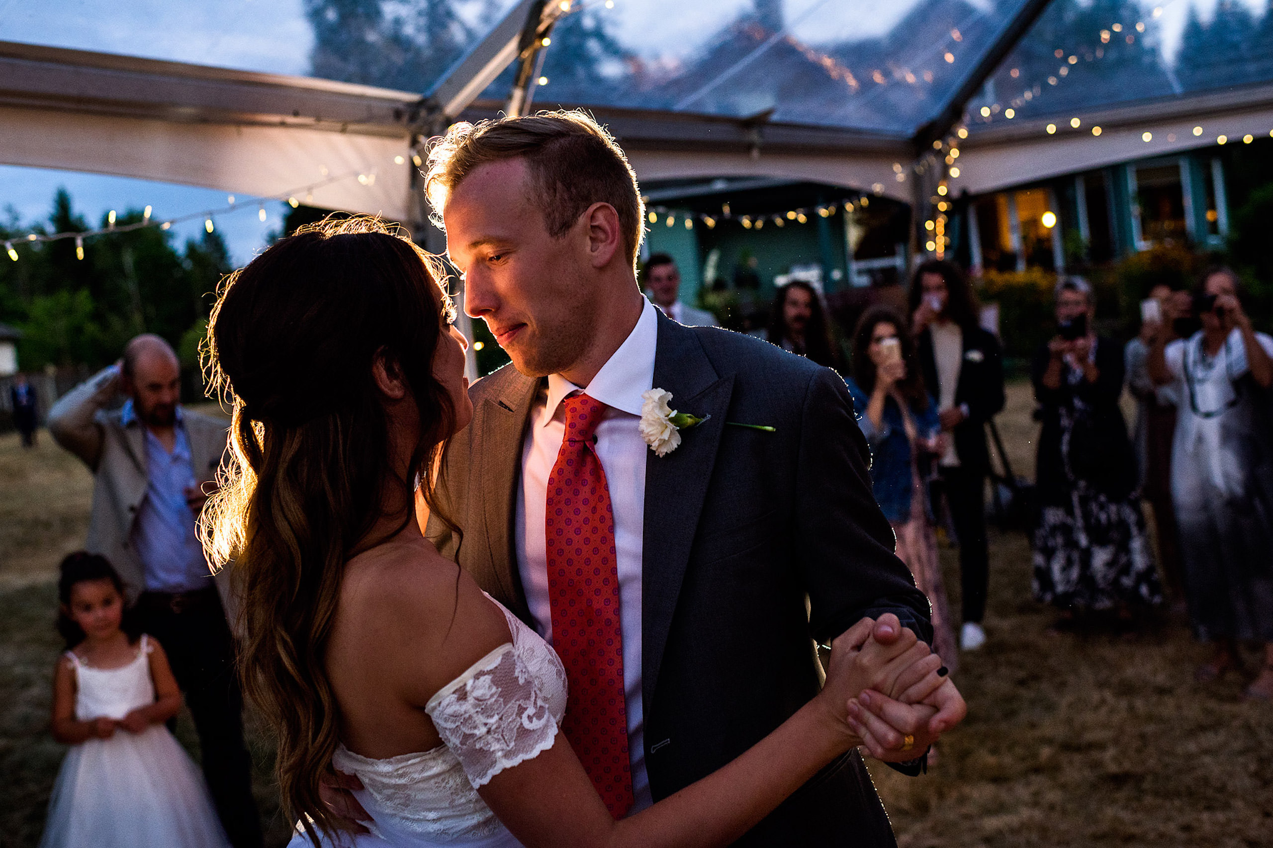 Bride and groom first dance in a tent in their backyard - Qualicum Wedding Photographer