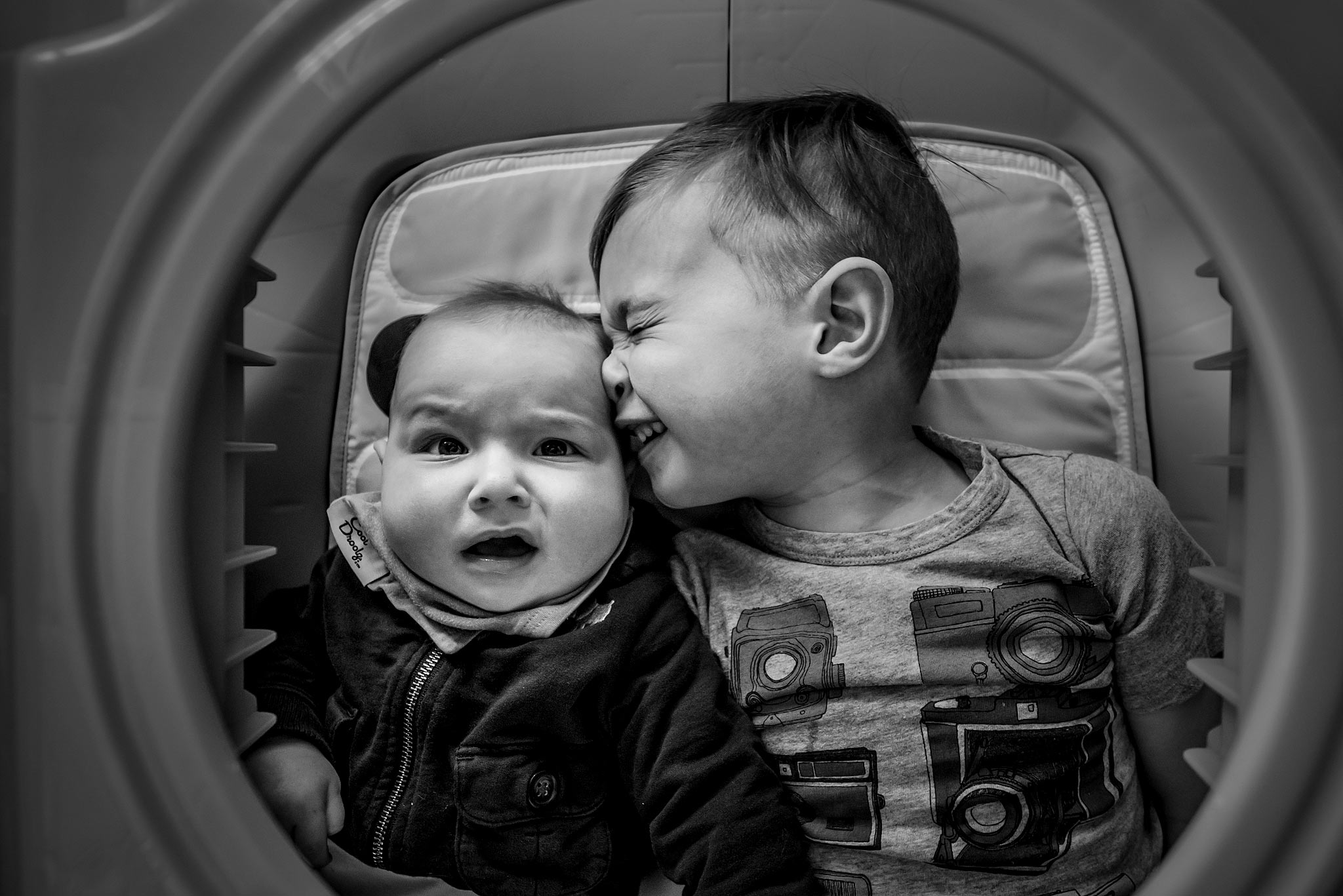 two brother making a funny face at each other by top family portrait photographer sean leblanc