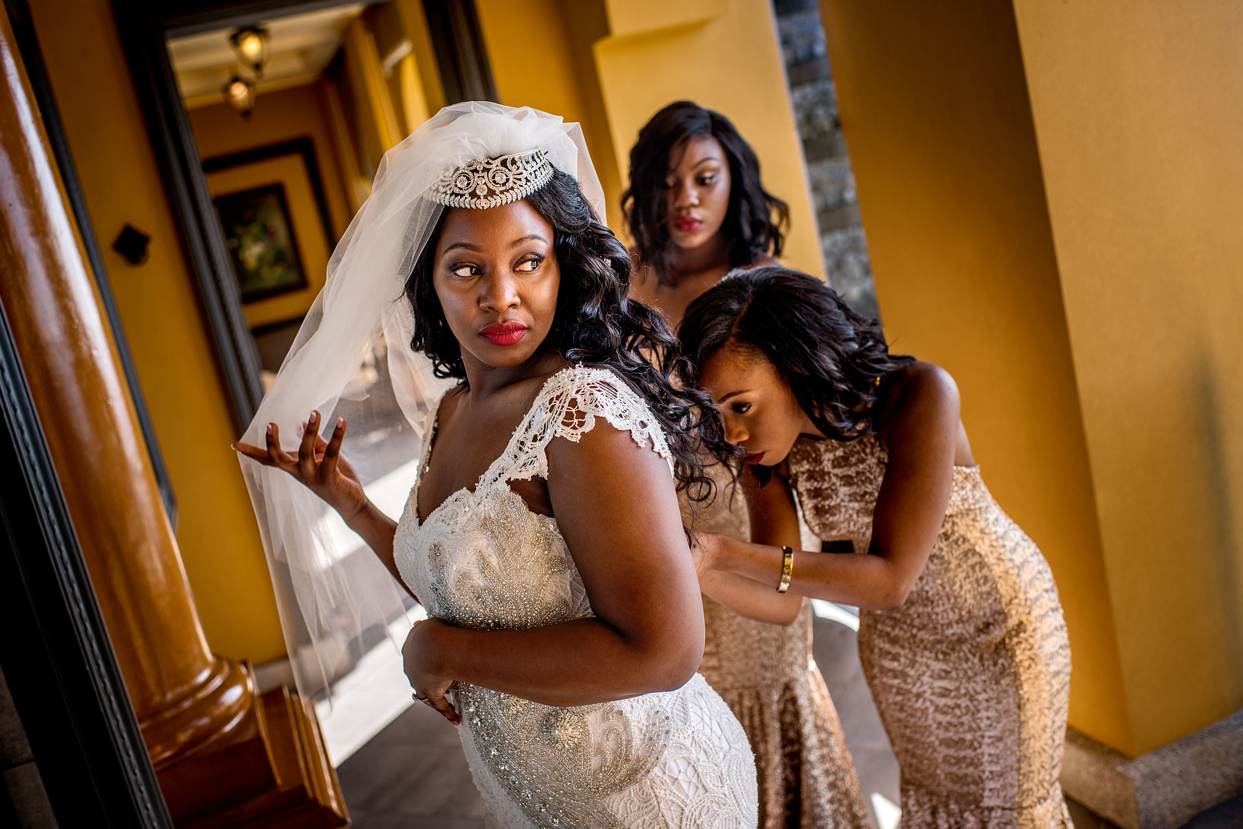 bridesmaids helping a bride get ready at Zephyr Palace Destination Wedding in Costa Rica by Sean LeBlanc