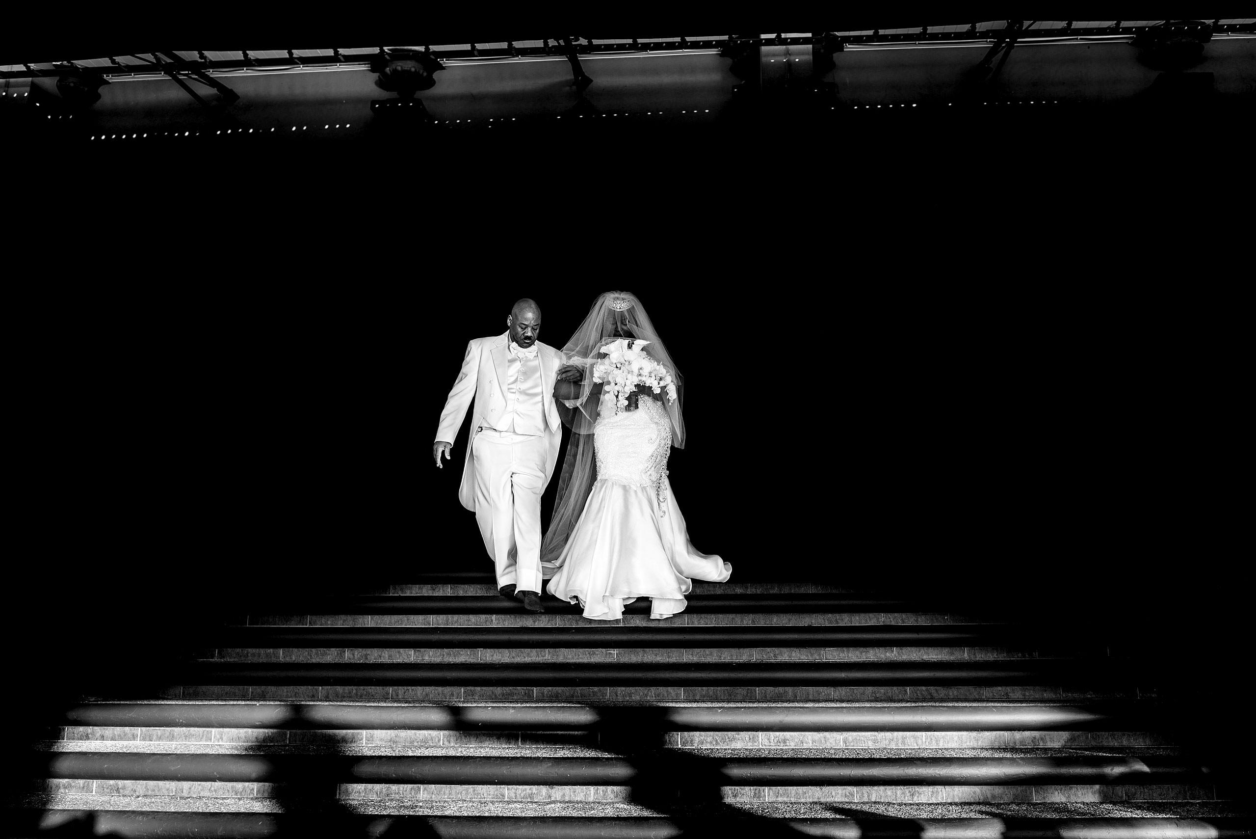 bride walking with her dad to her wedding reception by destination wedding photographer