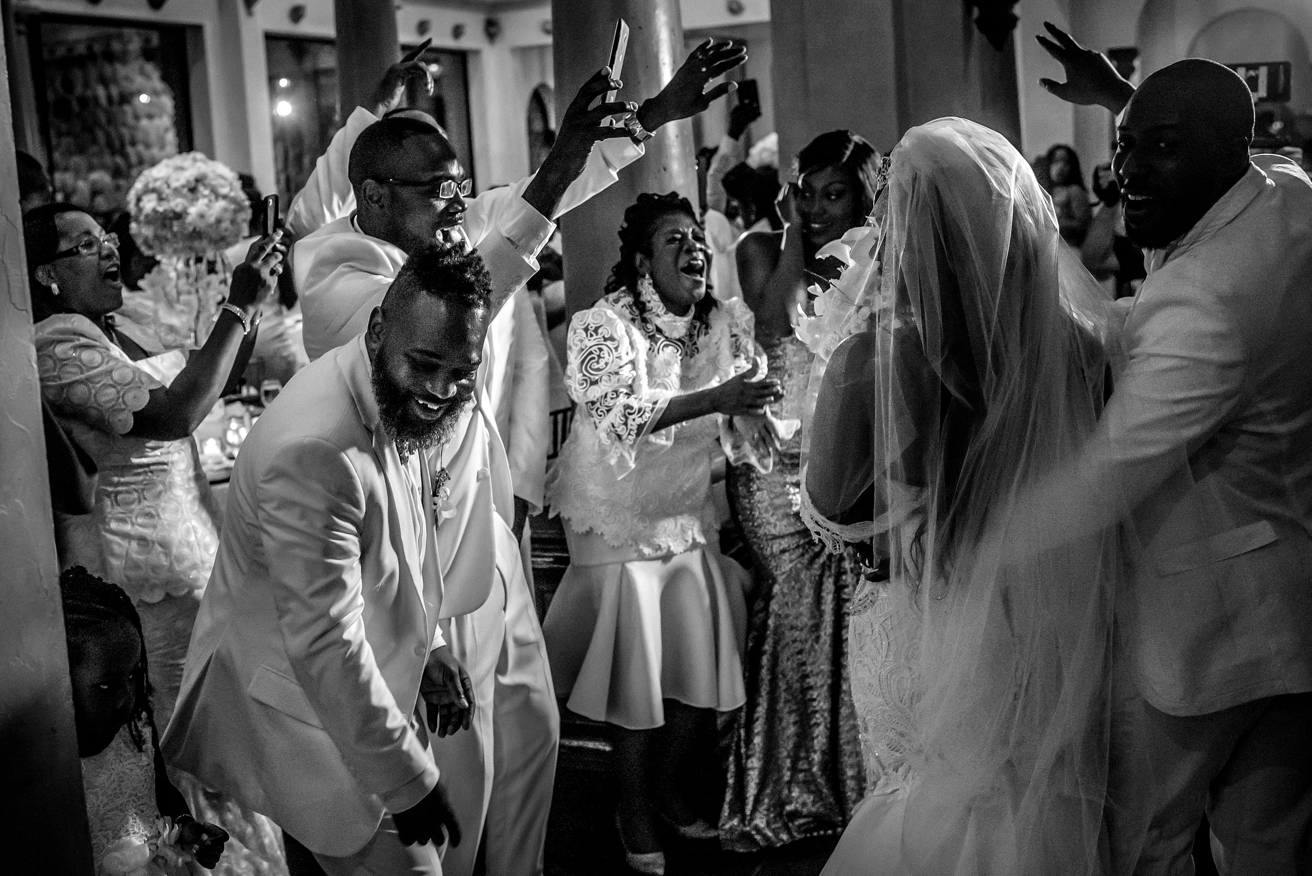 guests celebrating as a bride and groom enter the reception at Zephyr Palace Destination Wedding in Costa Rica by Sean LeBlanc