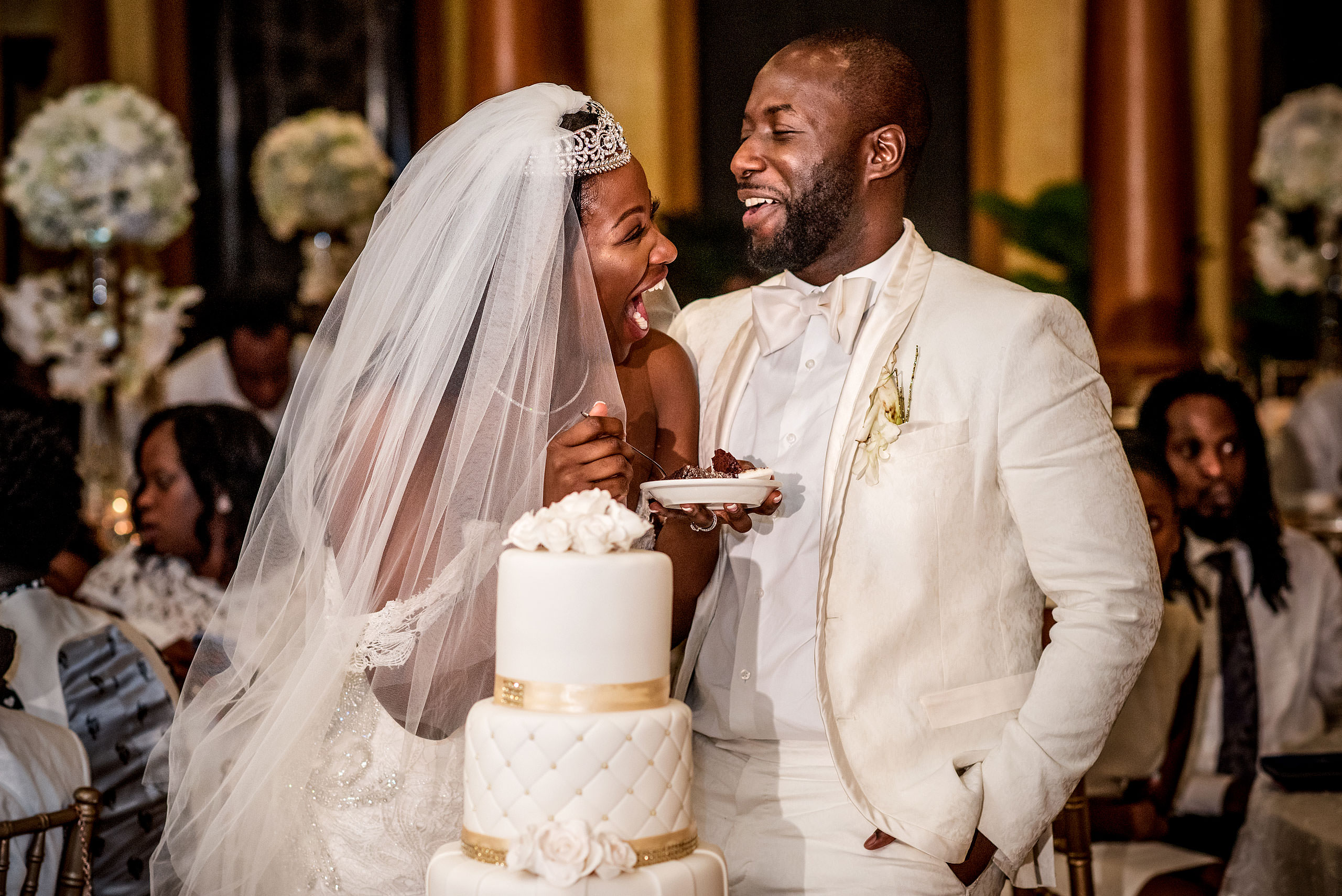 bride and groom laughing while eating cake at Costa Rica wedding