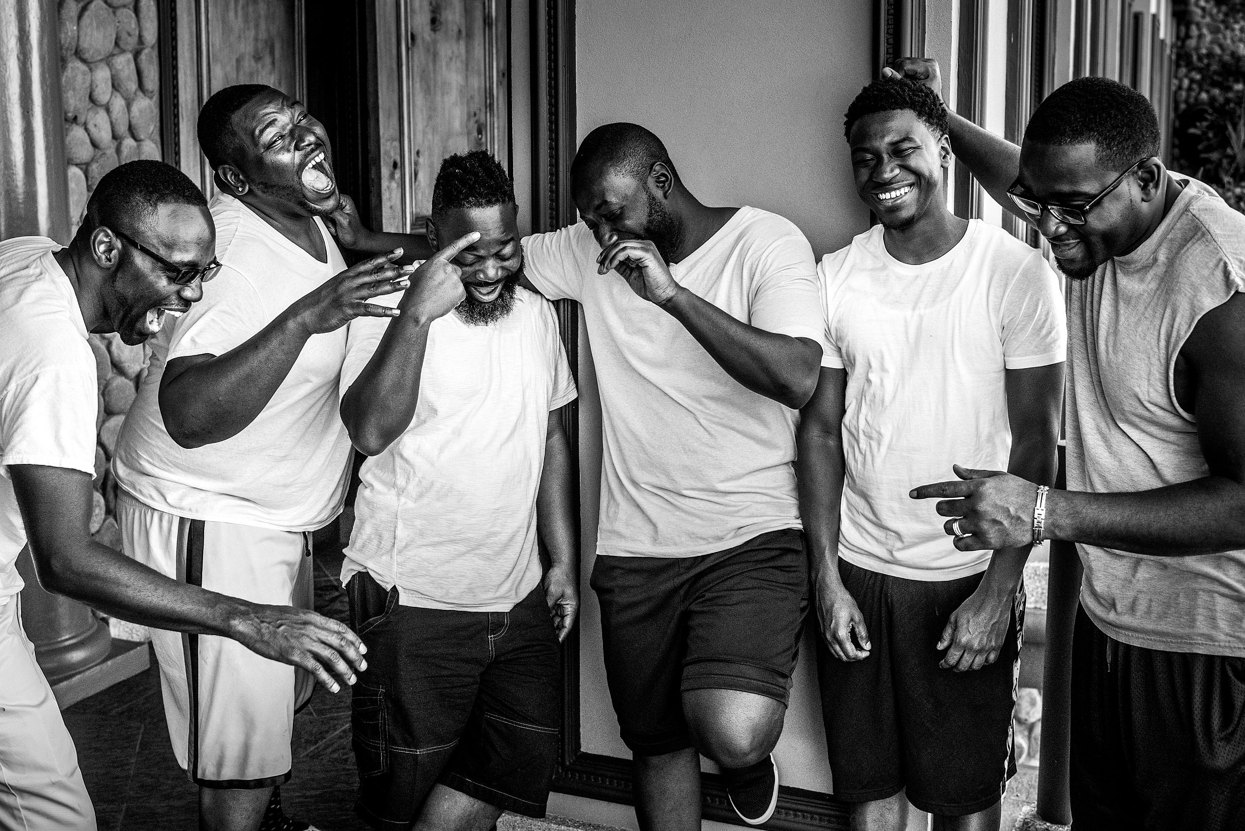 groomsmen joking around before a wedding day at Zephyr Palace Destination Wedding in Costa Rica by Sean LeBlanc