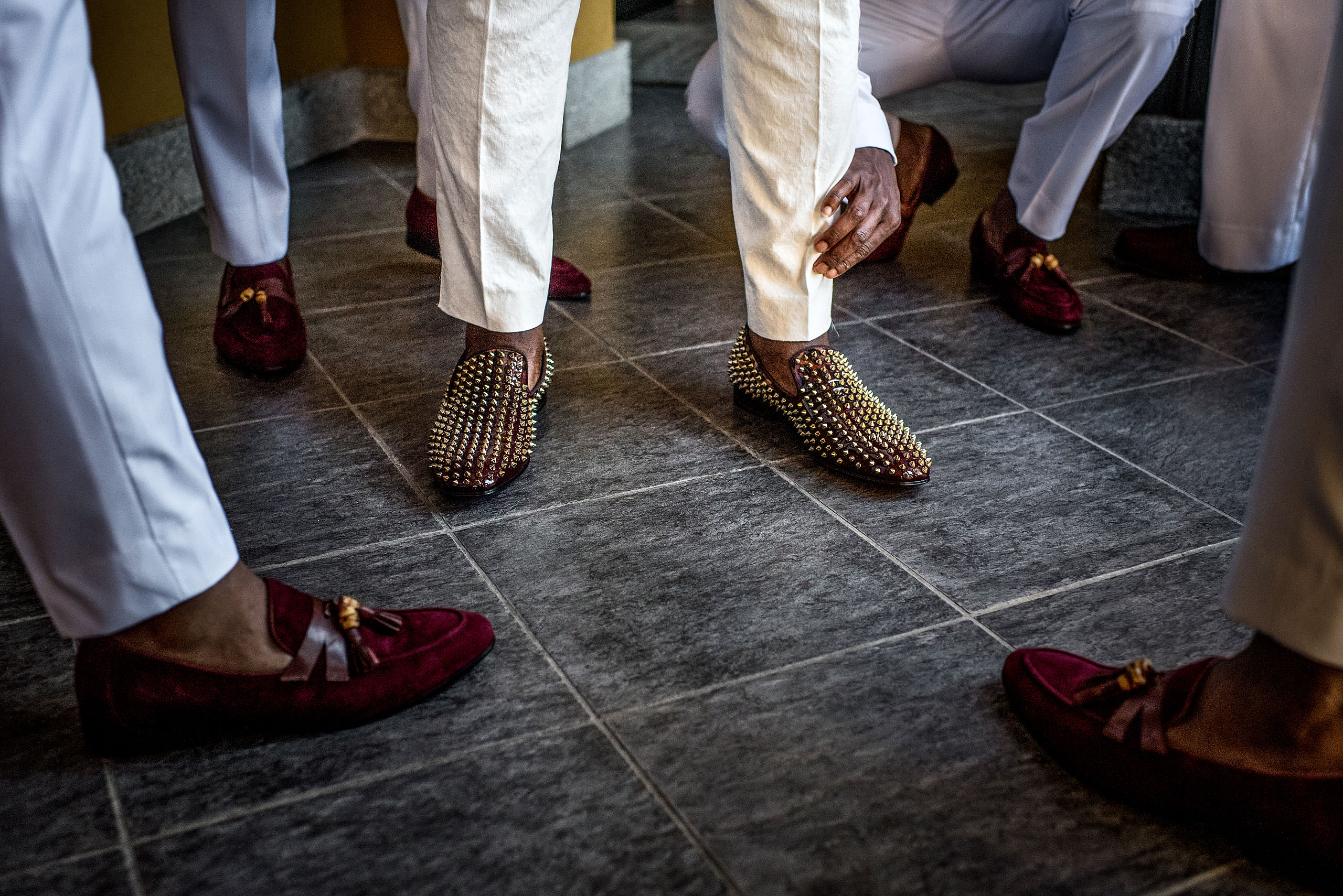 man wearing fancy shoes at Zephyr Palace Destination Wedding in Costa Rica by Sean LeBlanc