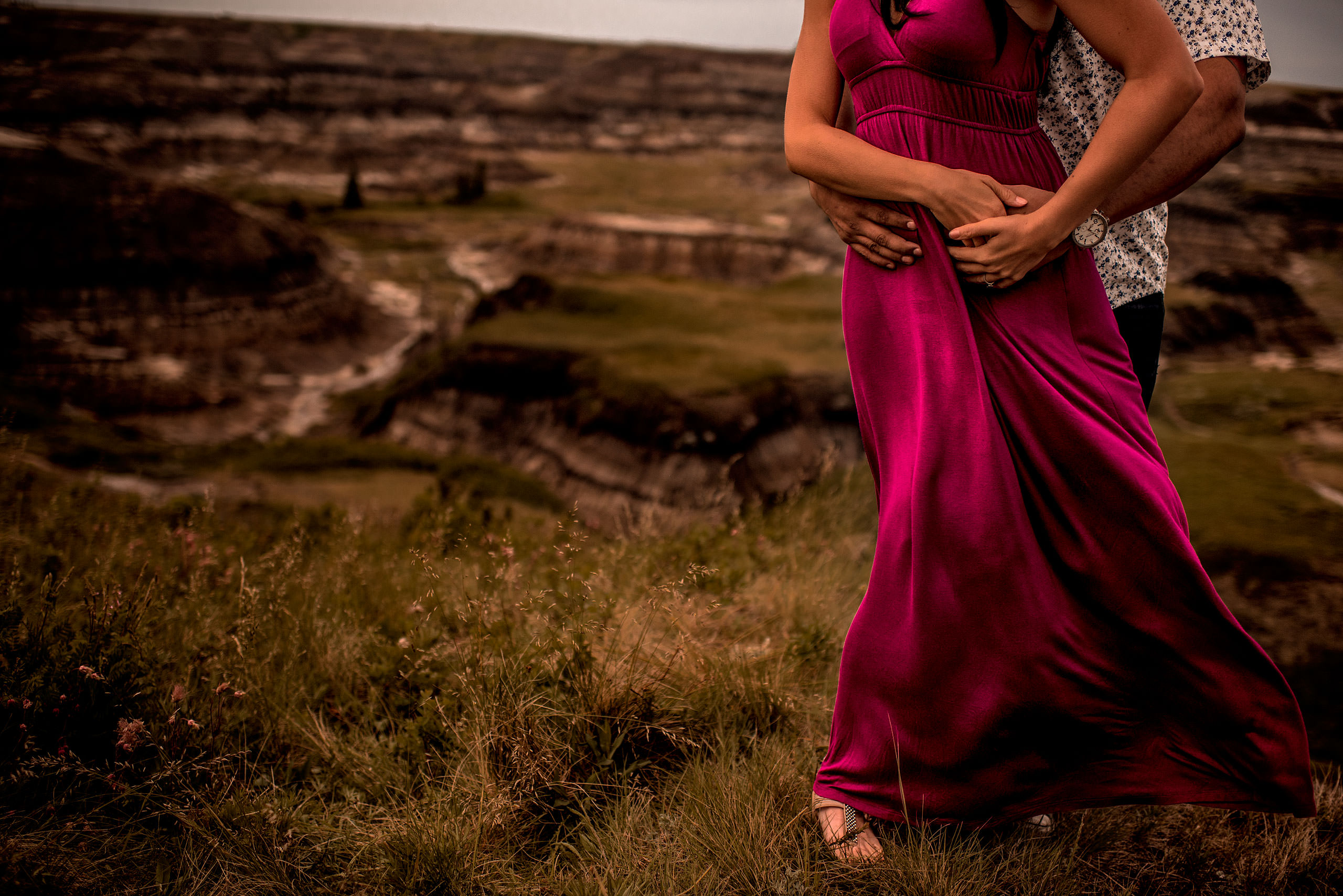 a detail photograph of a man holding his fiancé hand - drumheller engagement session