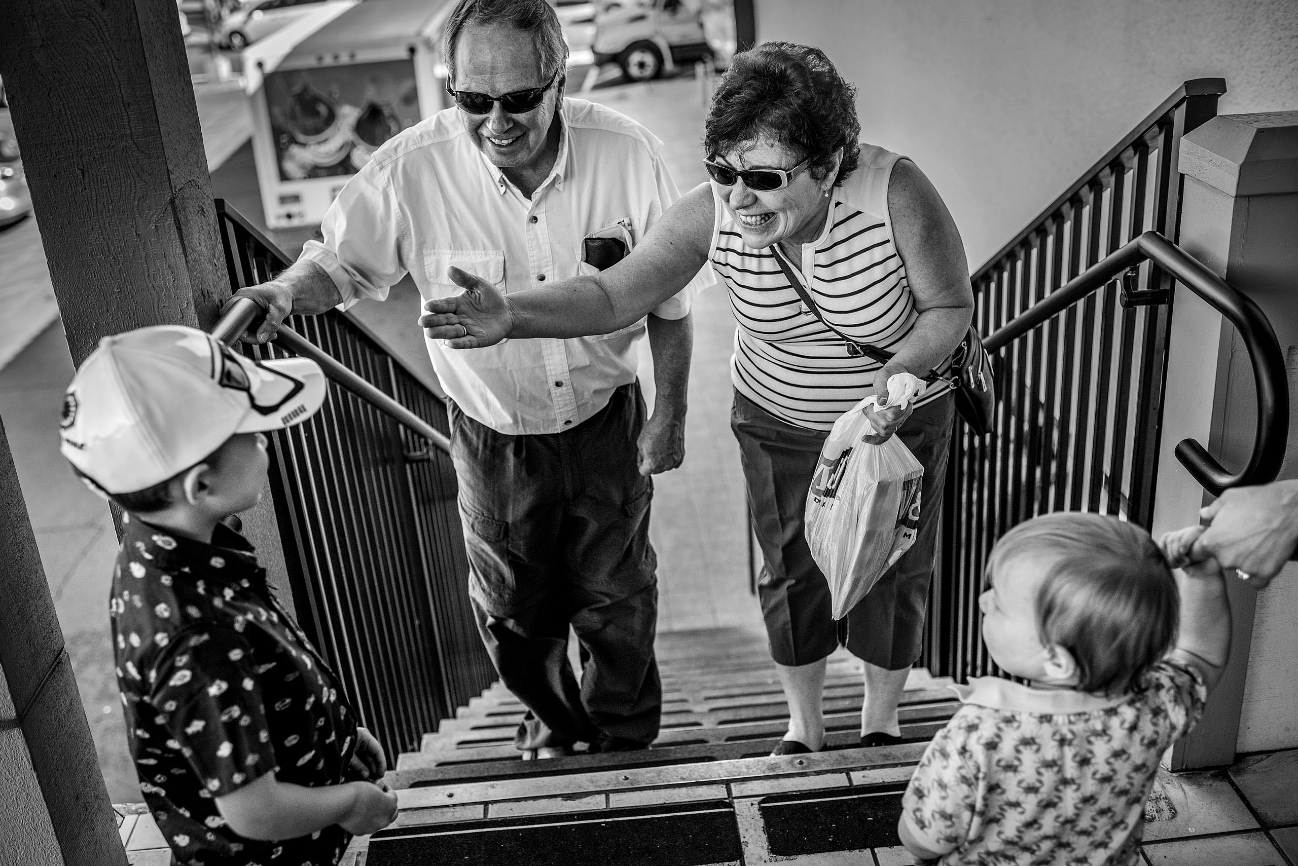 two grandparents seeing their grandchildren by destination family photographers sean leblanc