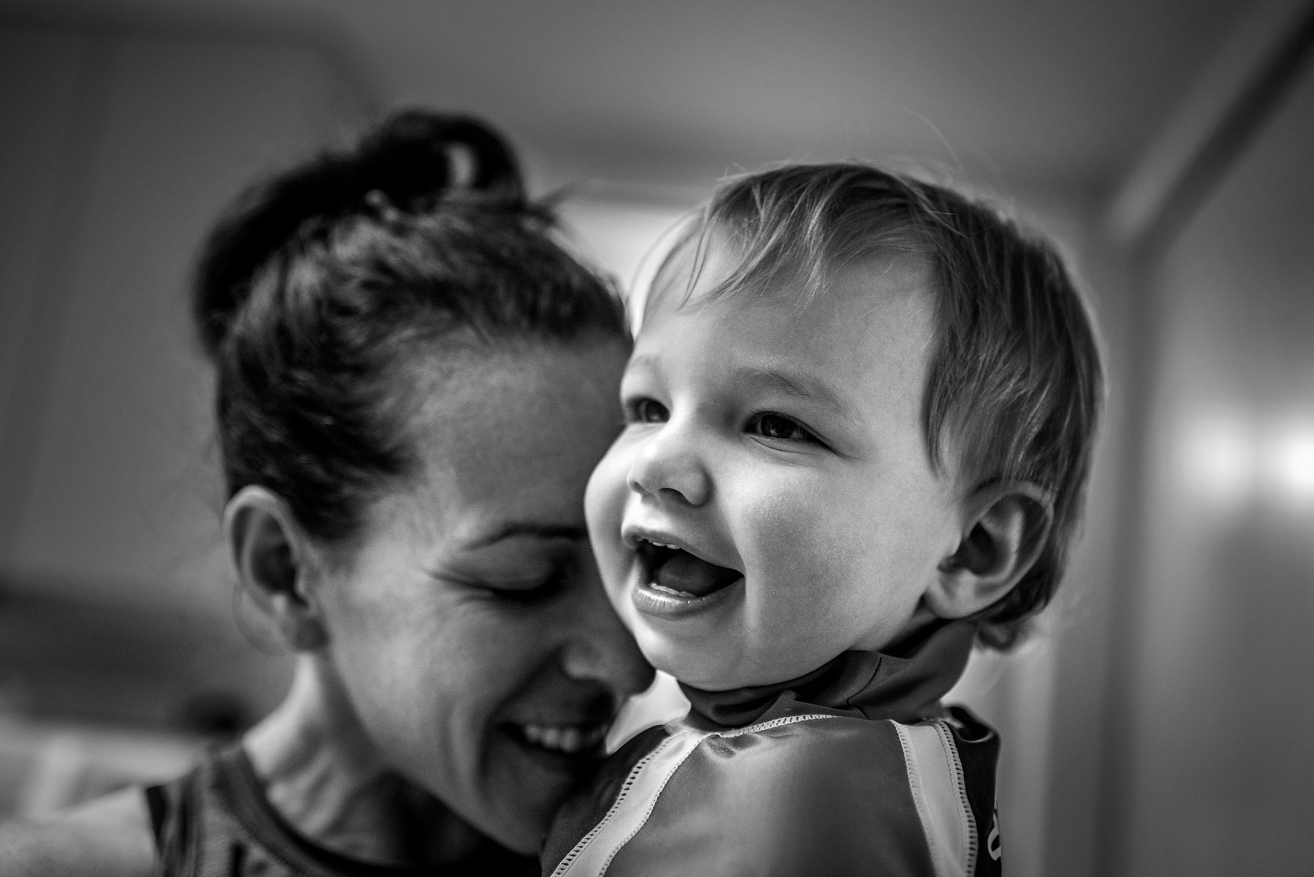 a mom holding her young son by destination family photographers sean leblanc