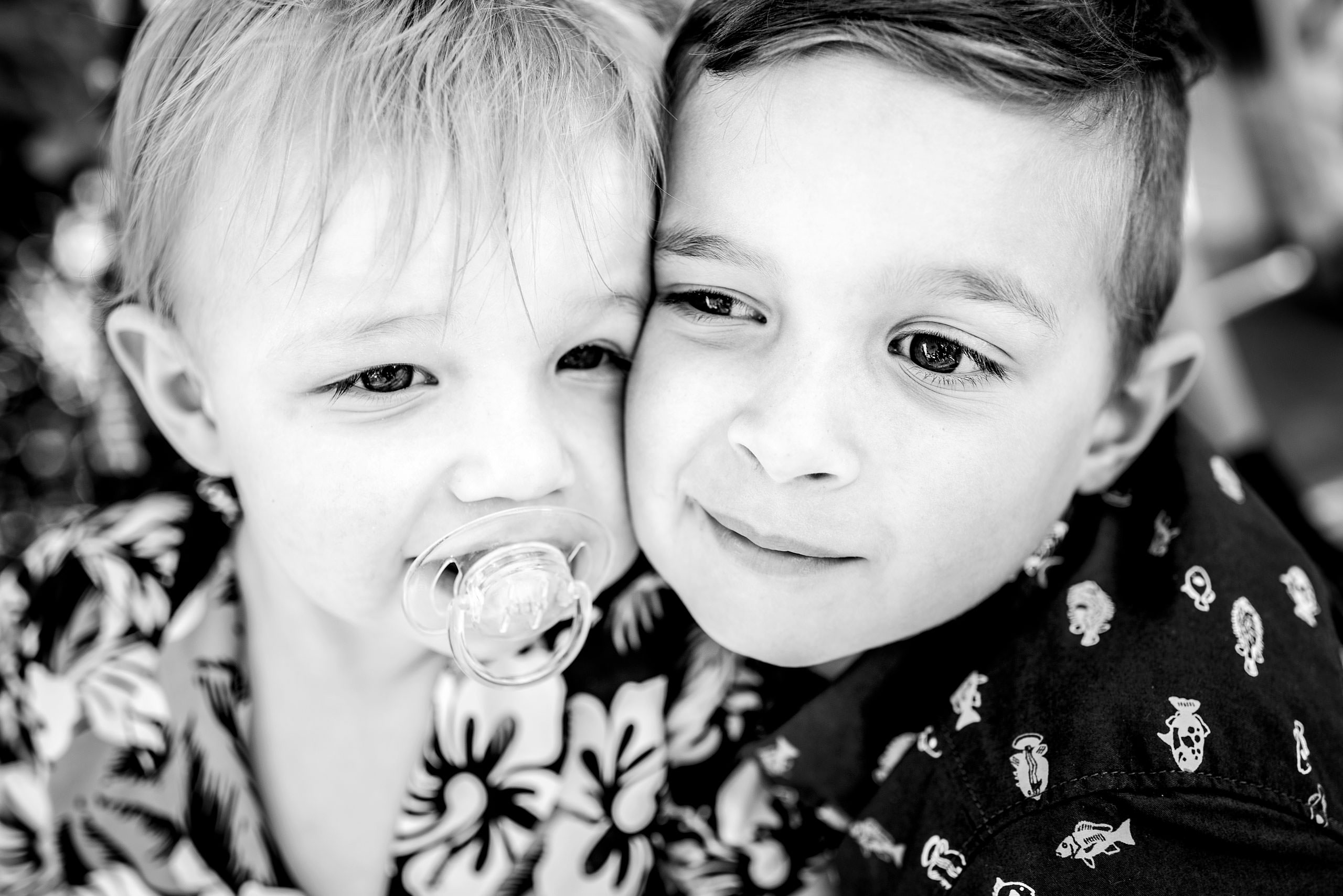 two brothers with their faces close together by destination family photographers sean leblanc
