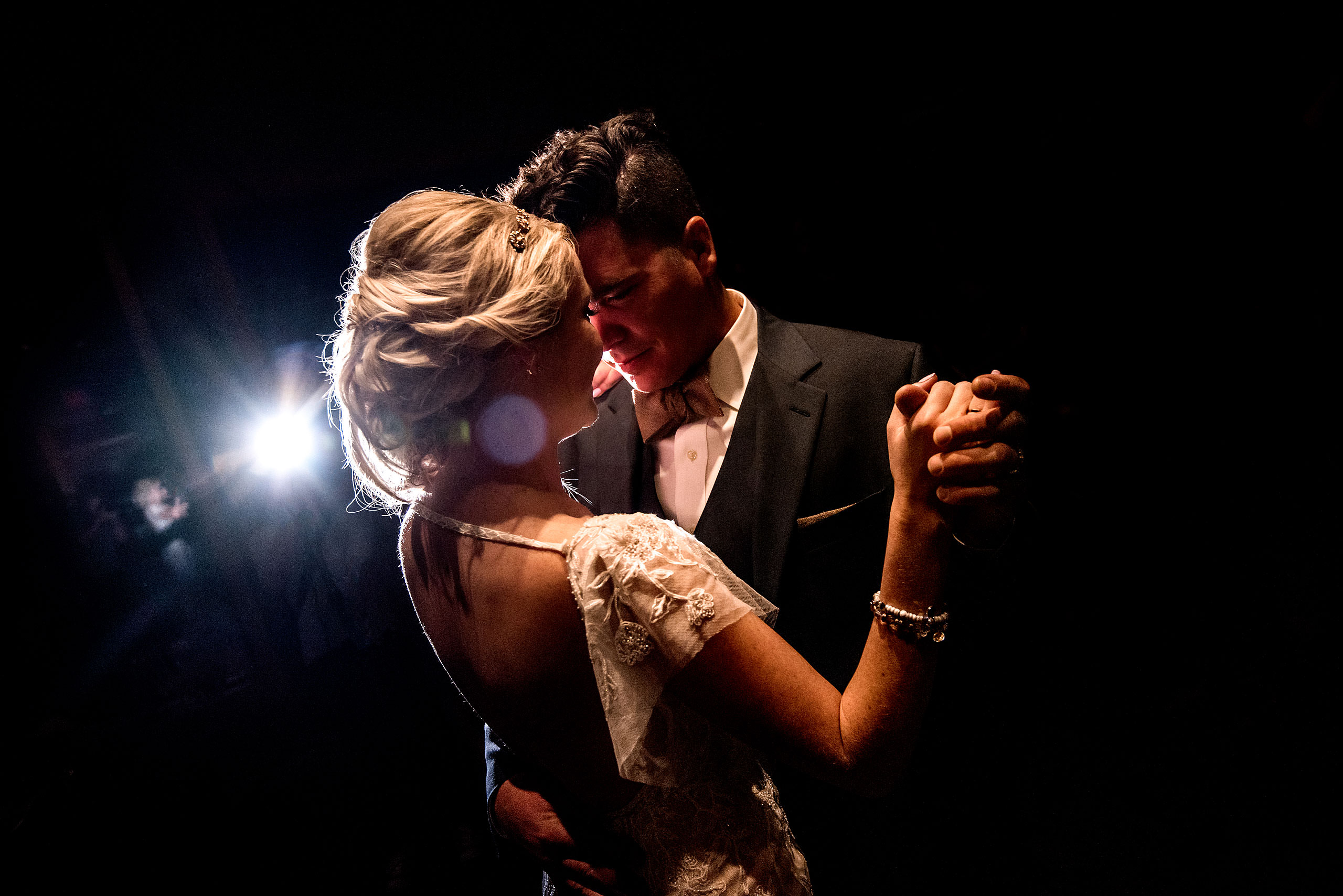 bride and groom having first dance at winter kicking horse wedding