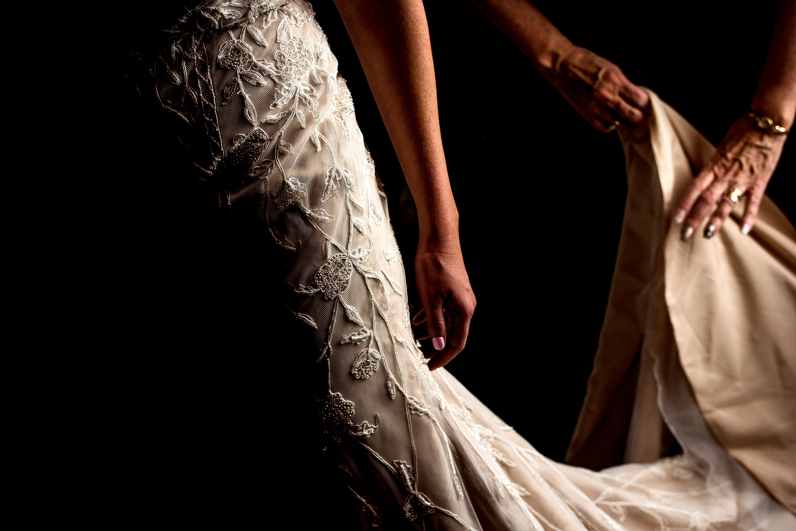 detail photograph of a bride's wedding dress by calgary wedding photographers