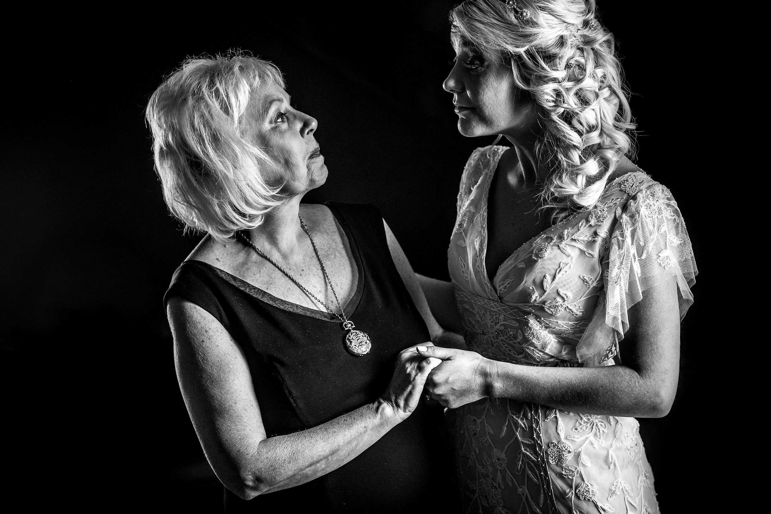 mom and daughter having a moment at winter kicking horse wedding