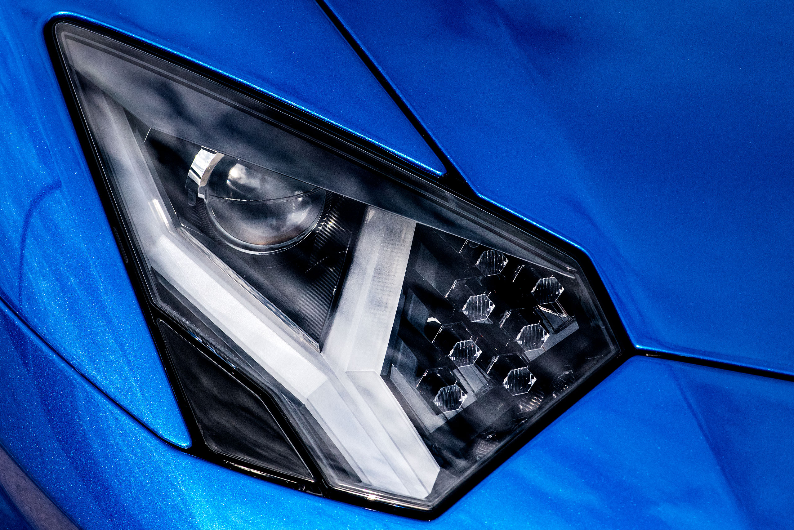 metallic blue Lamborghini aventador close up photograph of the headlight