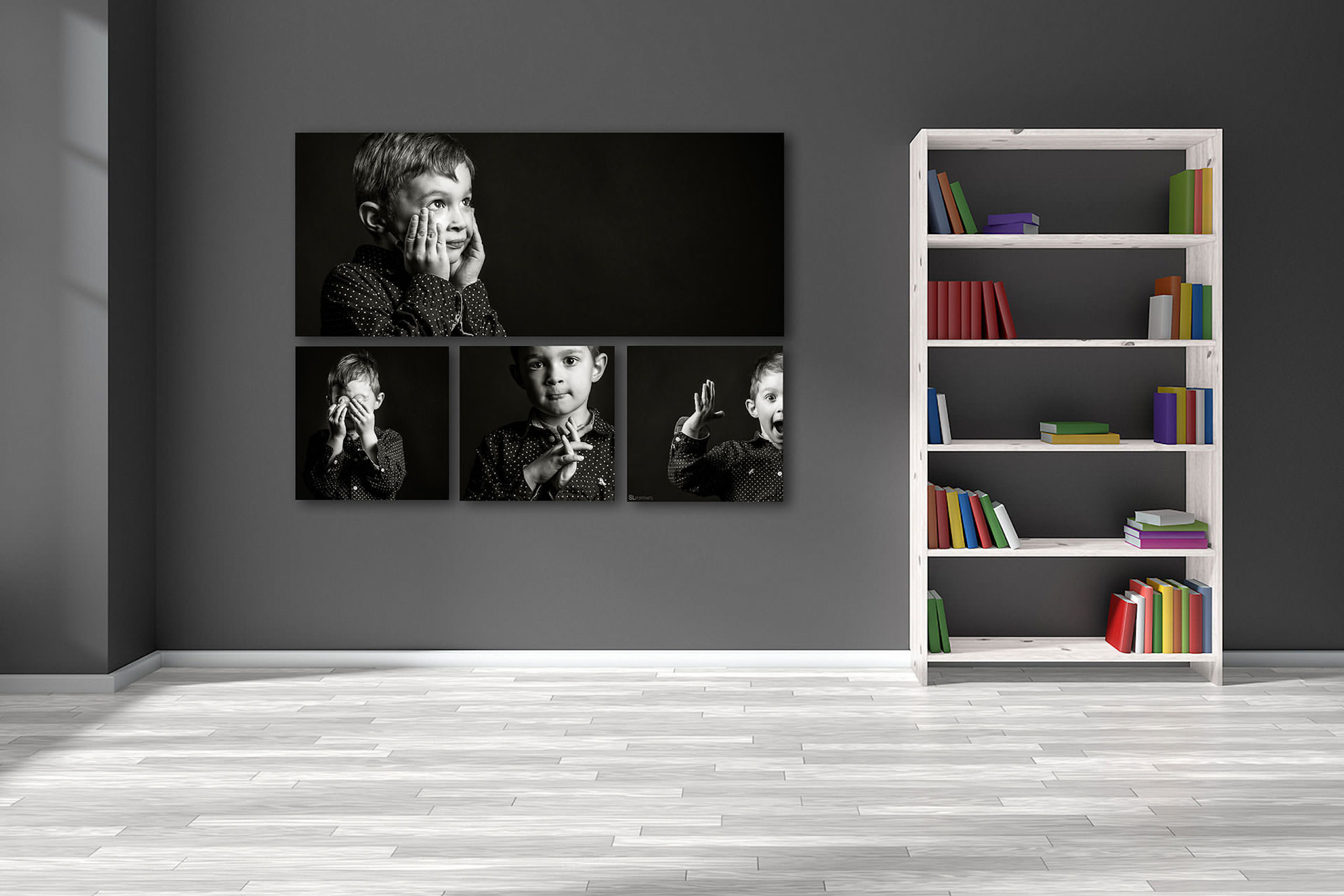 large wall art collection of a little boy in black and white hung on a grey wall by top calgary portrait photographer sean leblanc