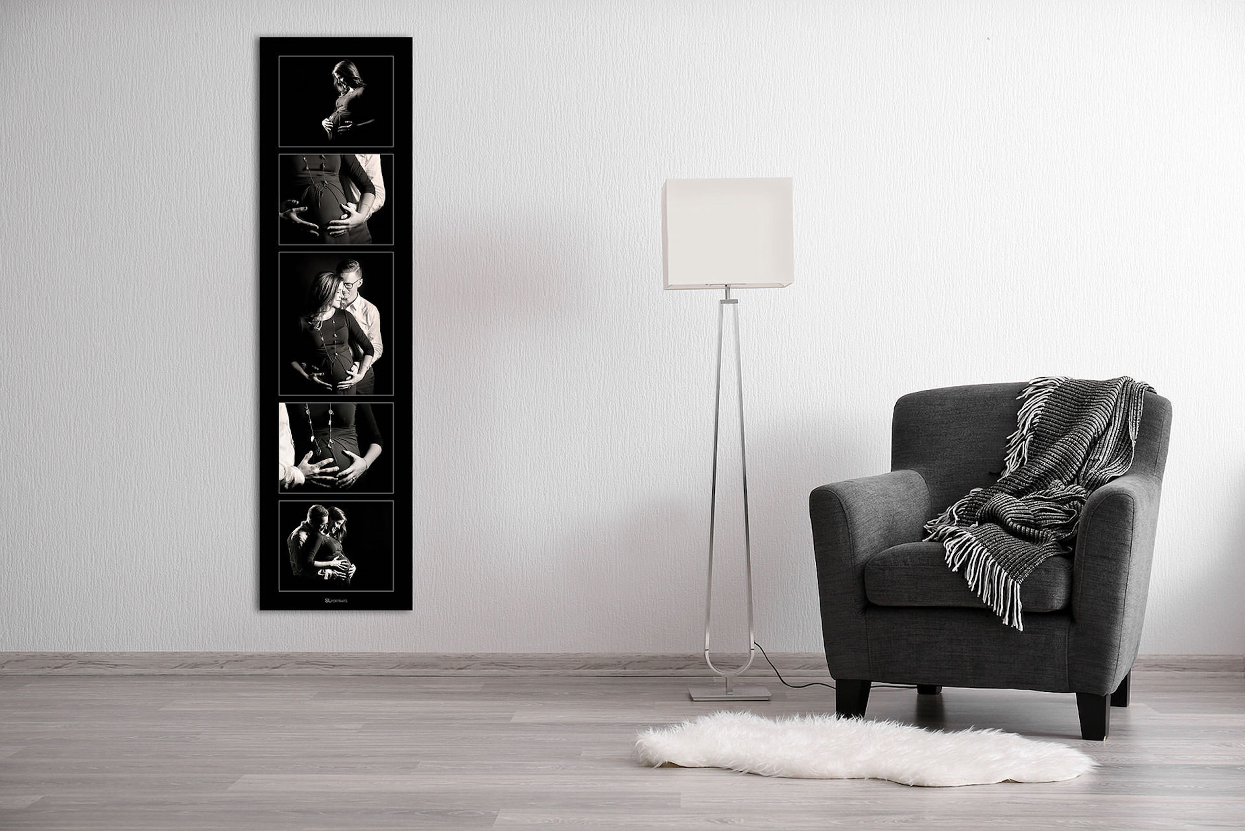 large wall art collection beside a lamp and chair by top calgary portrait photographer sean leblanc