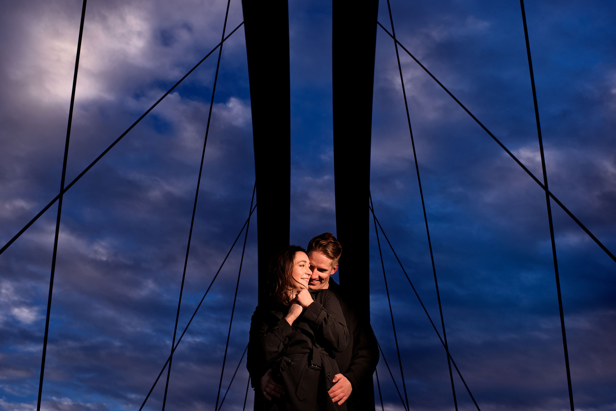 an engaged couple on a bridge at a Calgary East Village Engagement Session