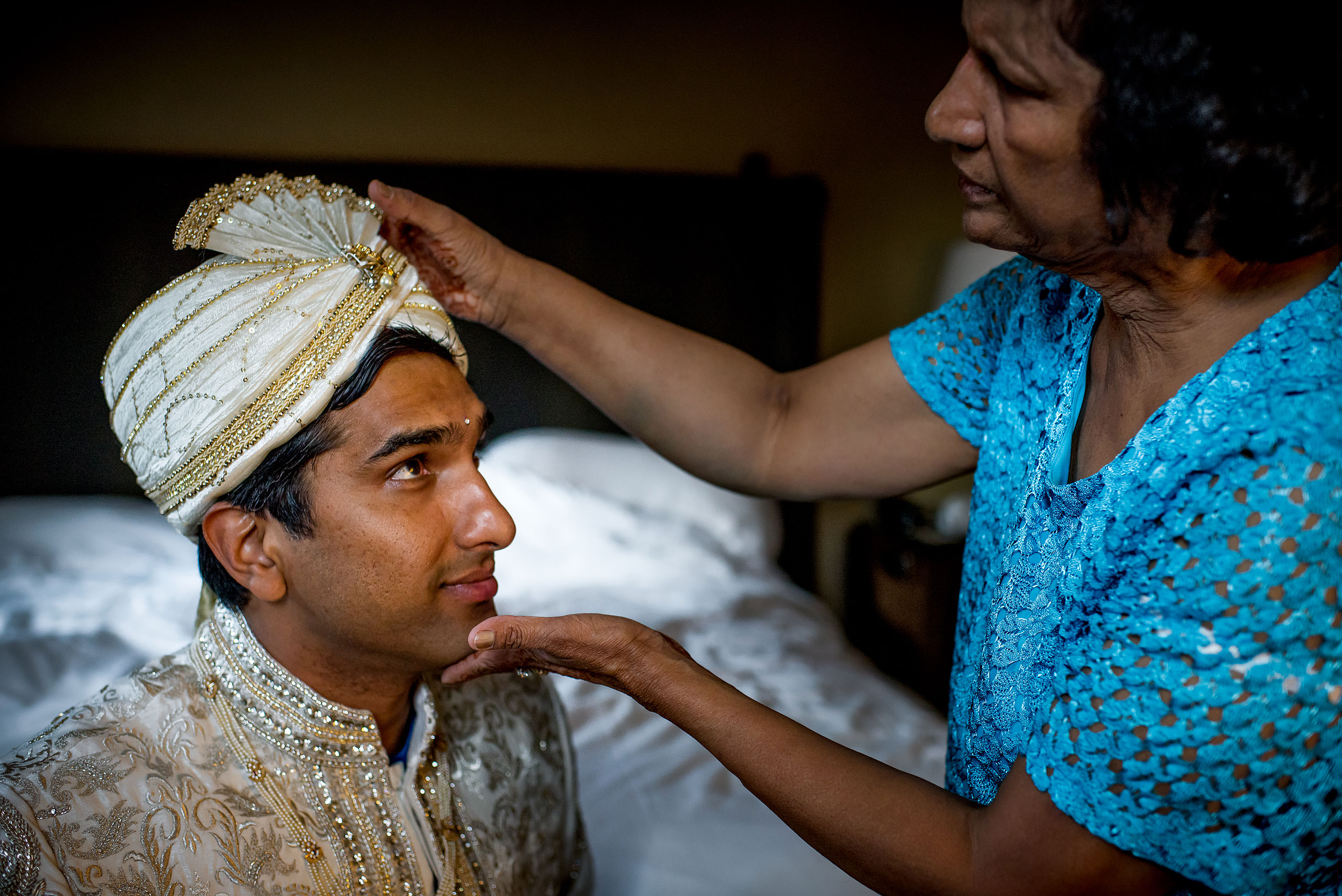 indian groom looking at his mom for cascade ballroom banff springs wedding by sean leblanc