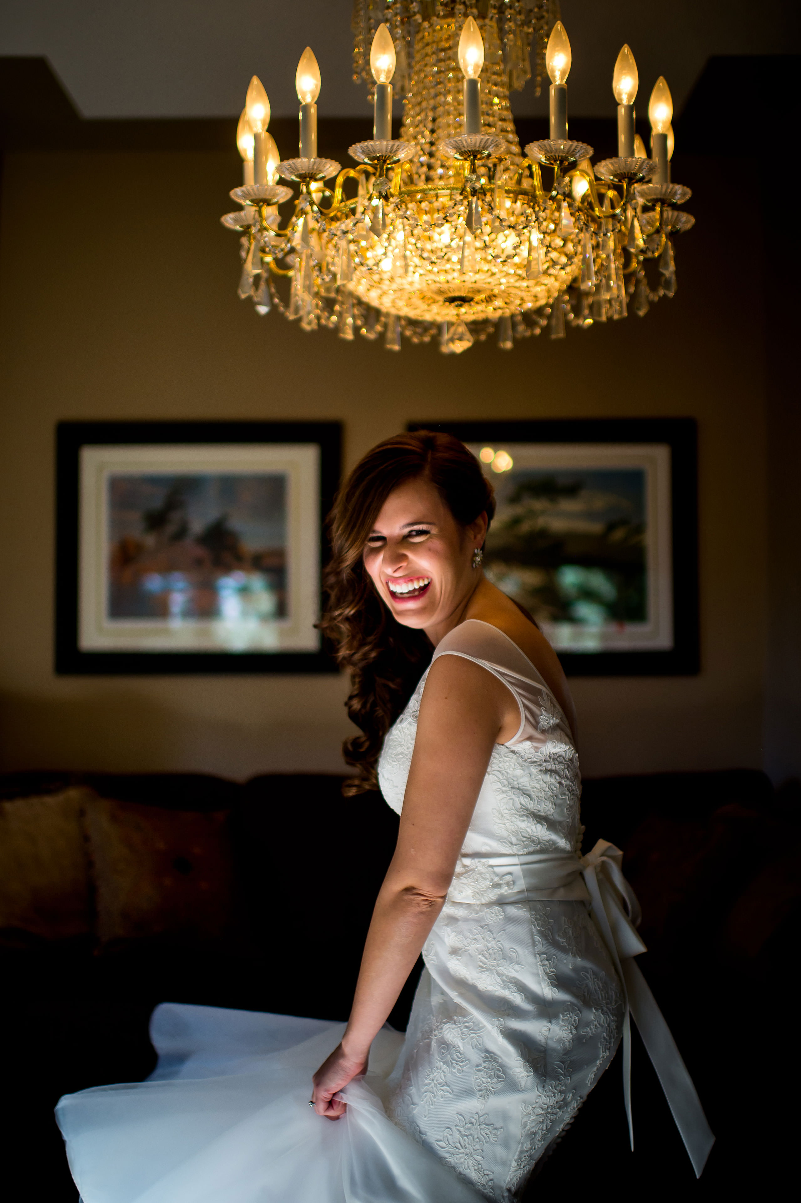 a bride spinning in her wedding dress under a lamp by Calgary Jewish Wedding Photographer Sean LeBlanc