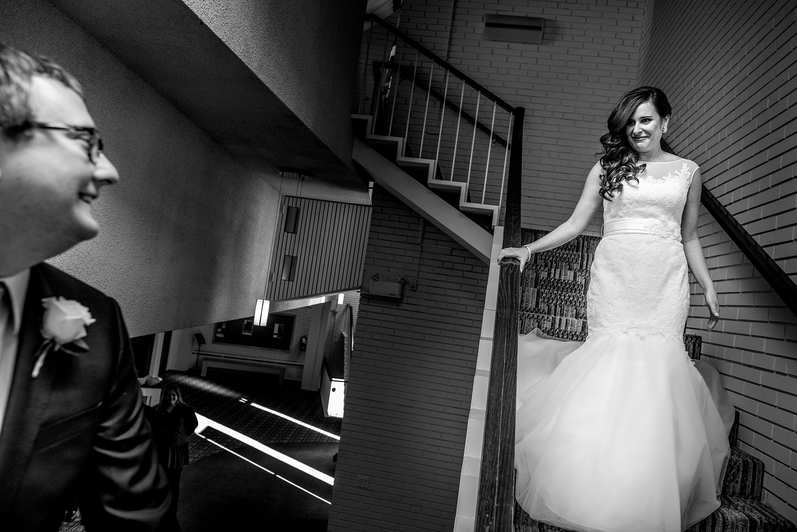 a bride walking down the stairs to meet her groom by Calgary Jewish Wedding Photographer Sean LeBlanc