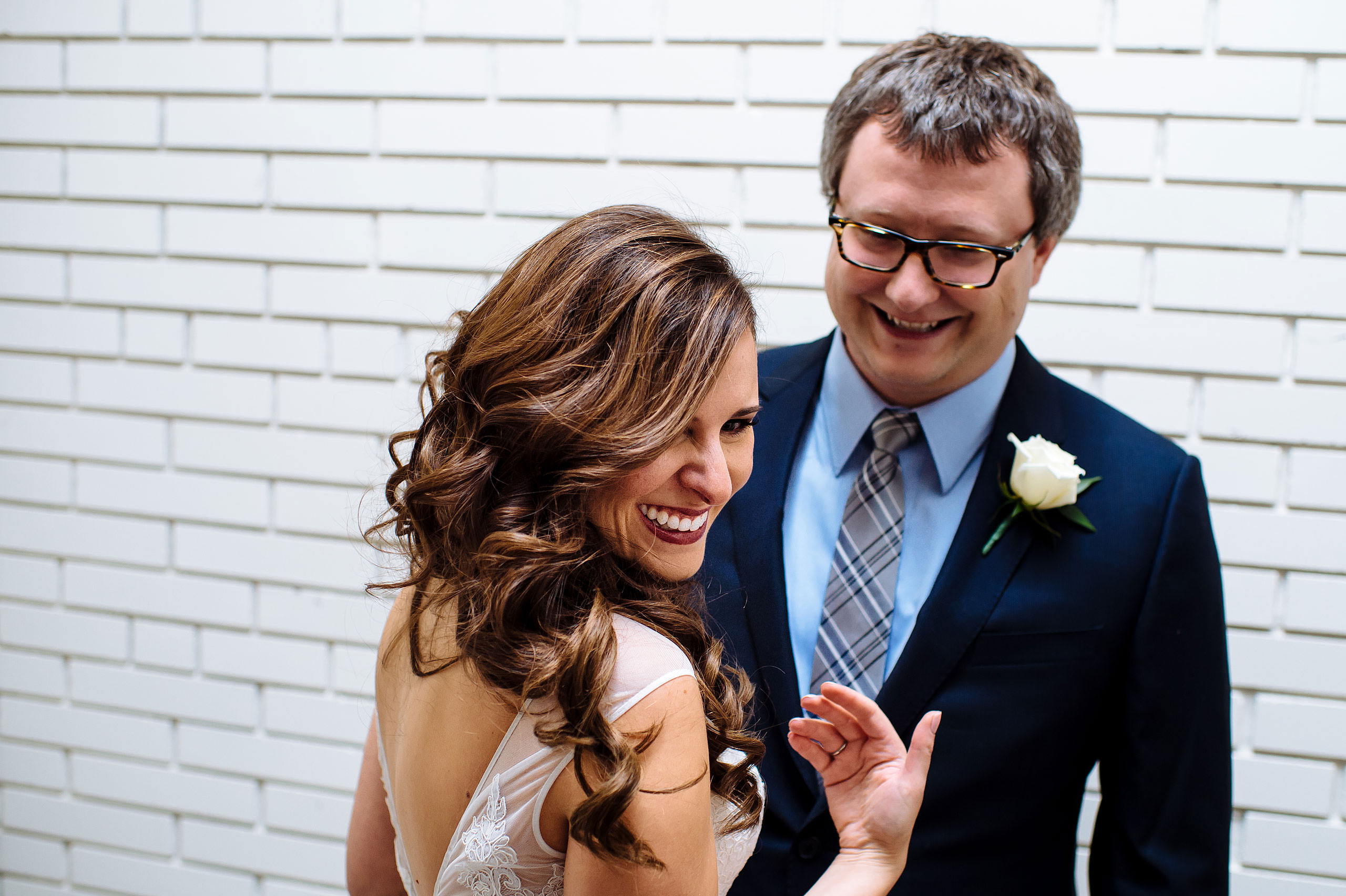 a bride seeing her groom for the first time by Calgary Jewish Wedding Photographer Sean LeBlanc