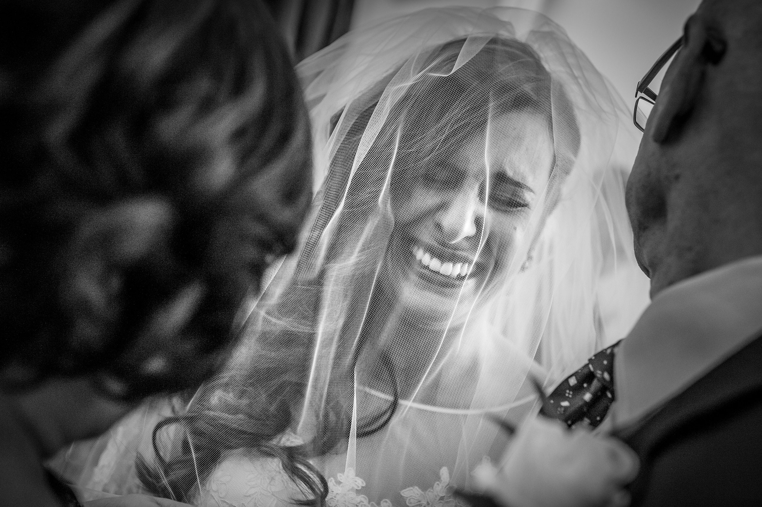 a bride crying with her parents by Calgary Jewish Wedding Photographer Sean LeBlanc