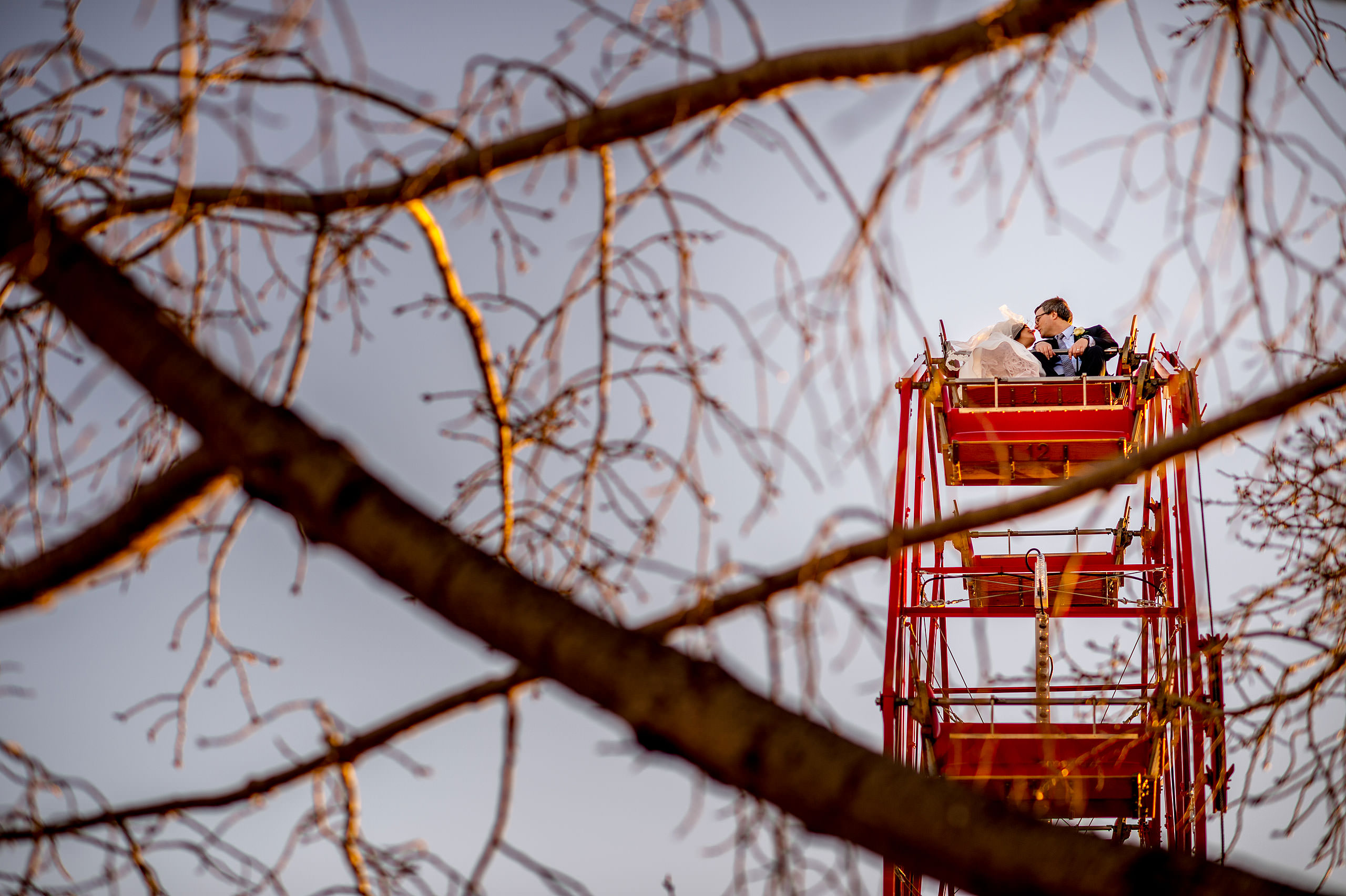a bride and groom on a Ferris wheel by Calgary Jewish Wedding Photographer Sean LeBlanc