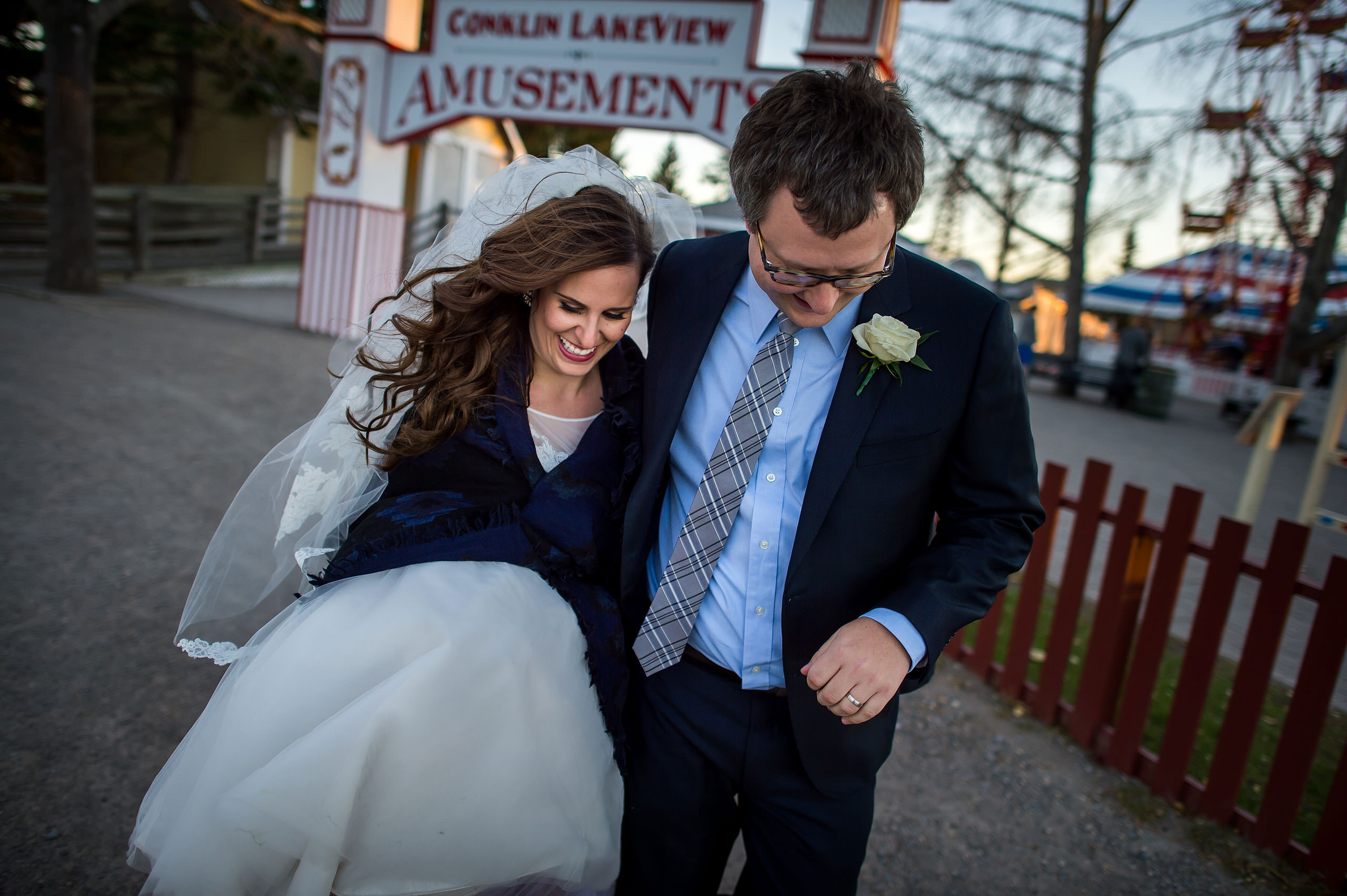 a bride and groom walking at dusk by Calgary Jewish Wedding Photographer Sean LeBlanc
