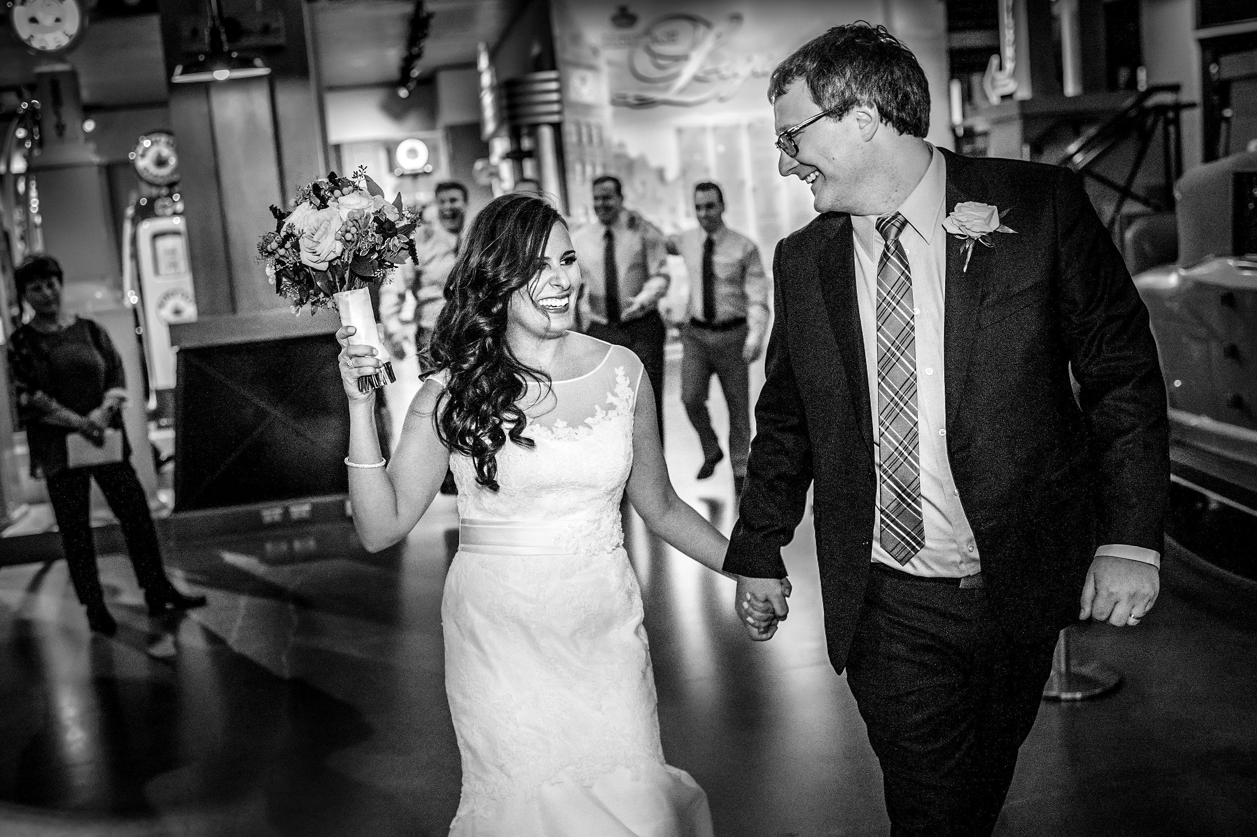 a bride and groom entering a reception hall by Calgary Jewish Wedding Photographer Sean LeBlanc