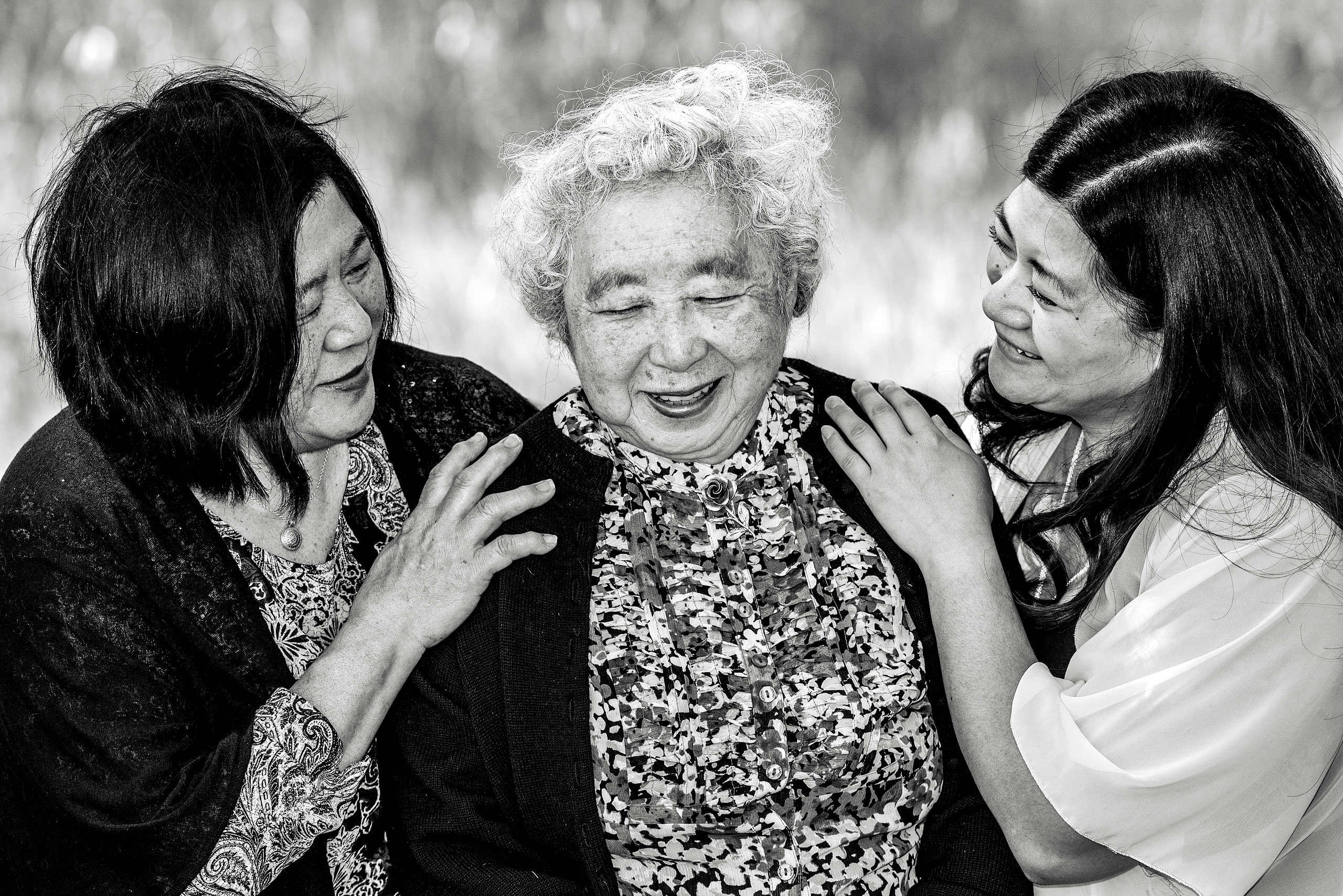 a grandma mother and daughter all laughing together by top family portrait photographer sean leblanc