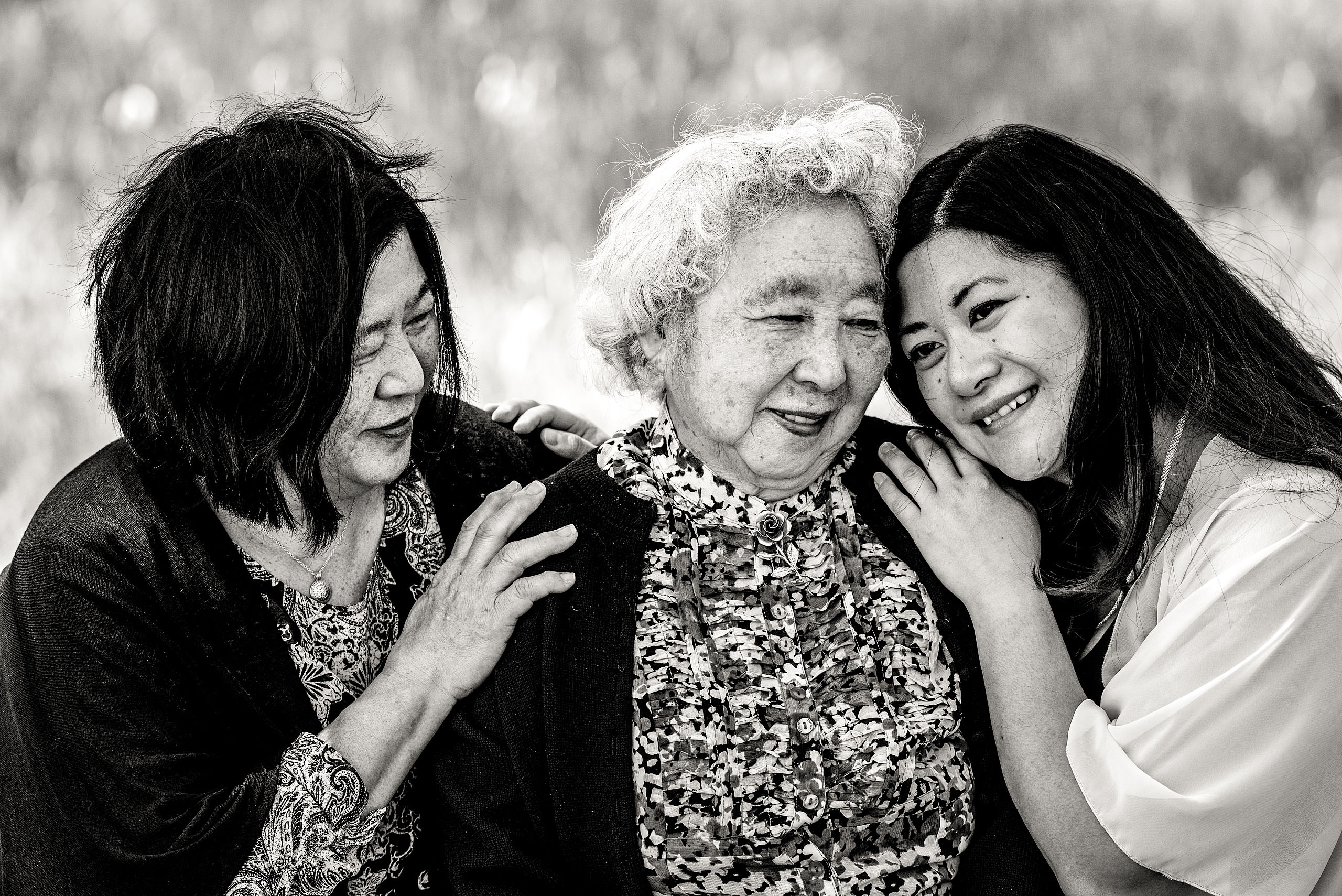 a grandmother mother and daughter sharing a special moment together by Calgary Maternity Photographer Sean LeBlanc