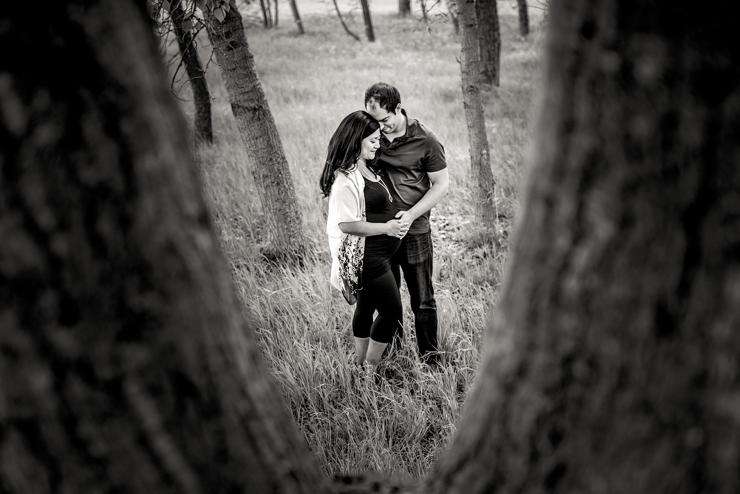 a pregnant women and her partner holding each other by Calgary Maternity Photographer Sean LeBlanc