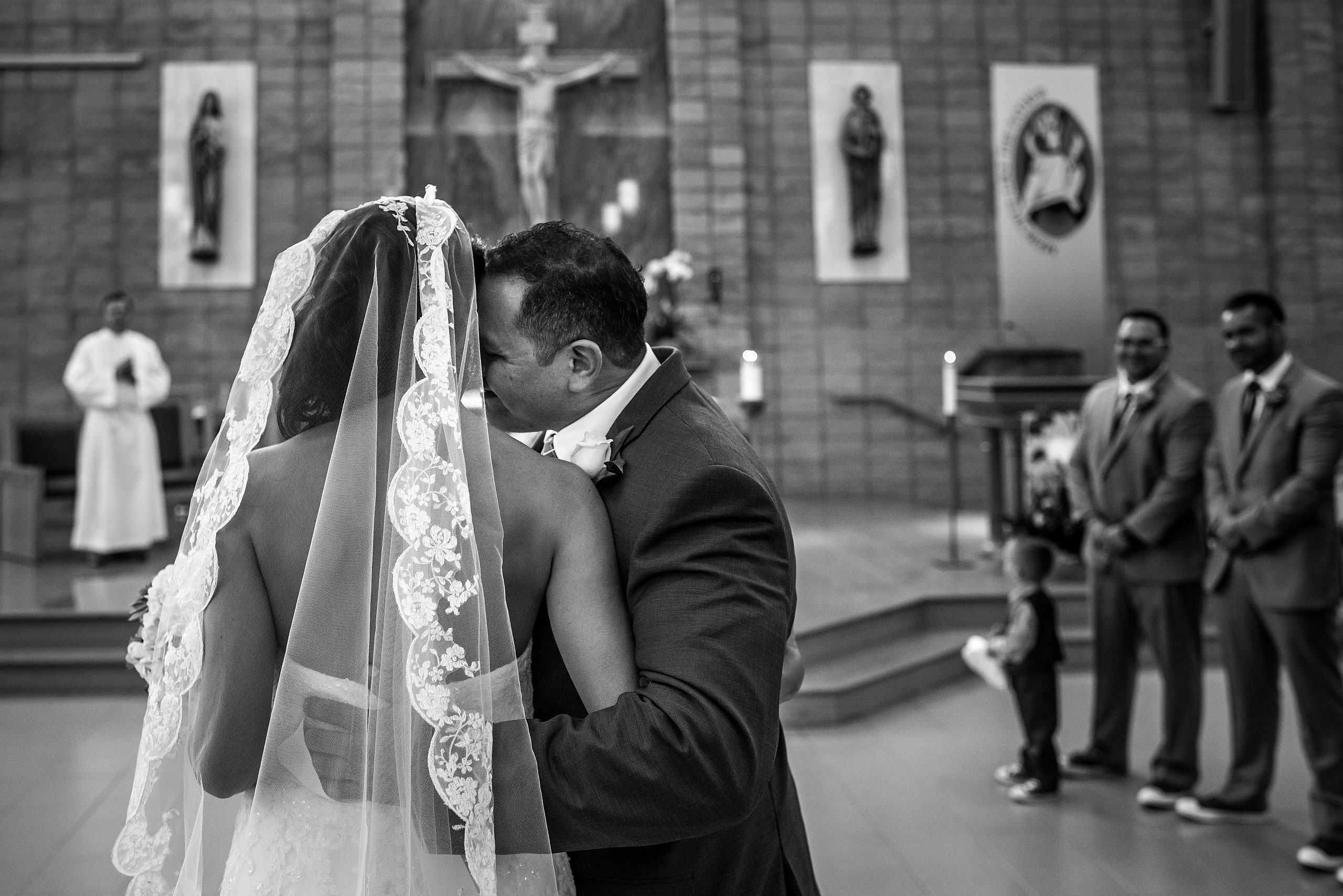 a groom hugging his bride by Edmonton wedding photographer sean leblanc