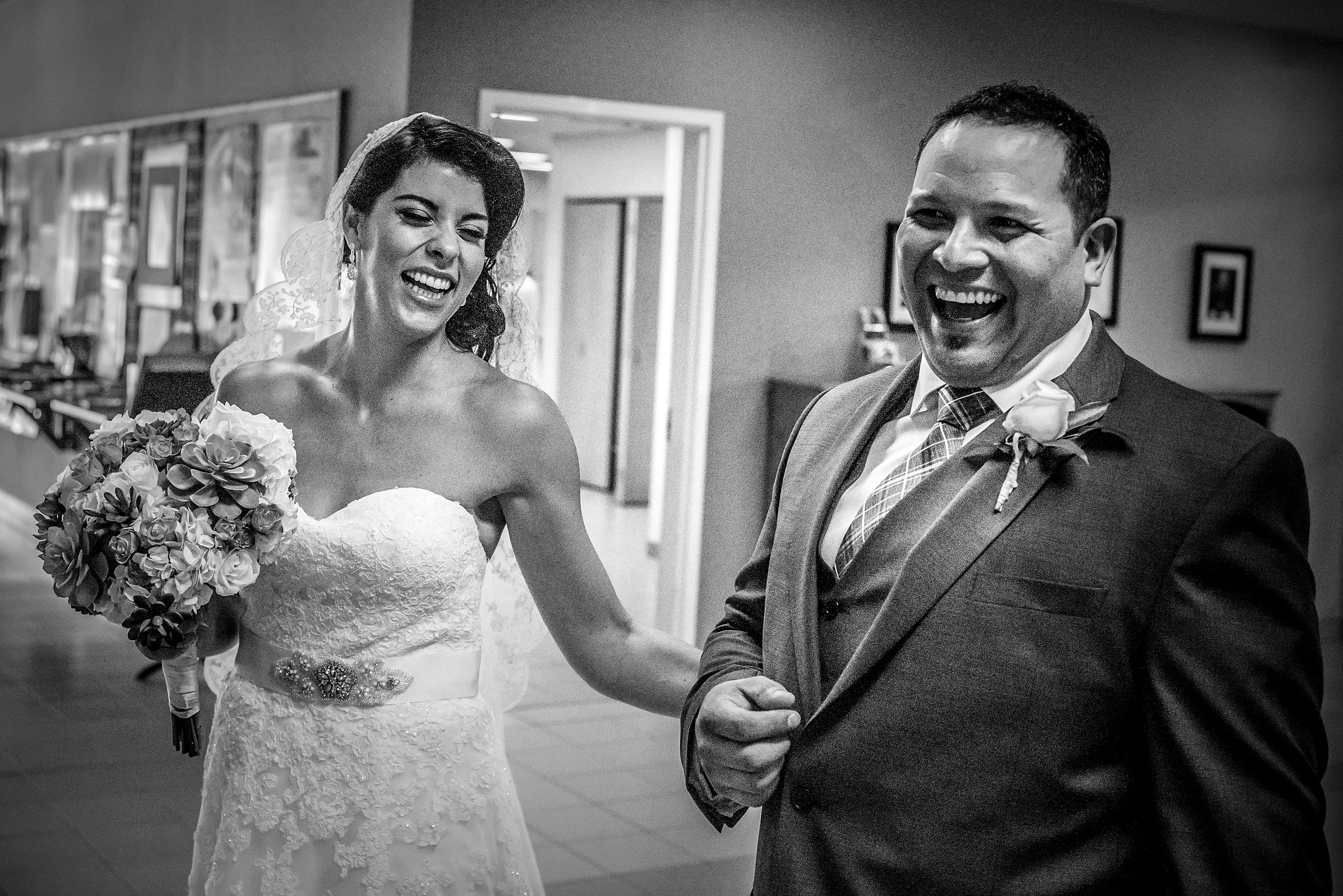a bride and groom laughing with each other by Edmonton wedding photographer sean leblanc