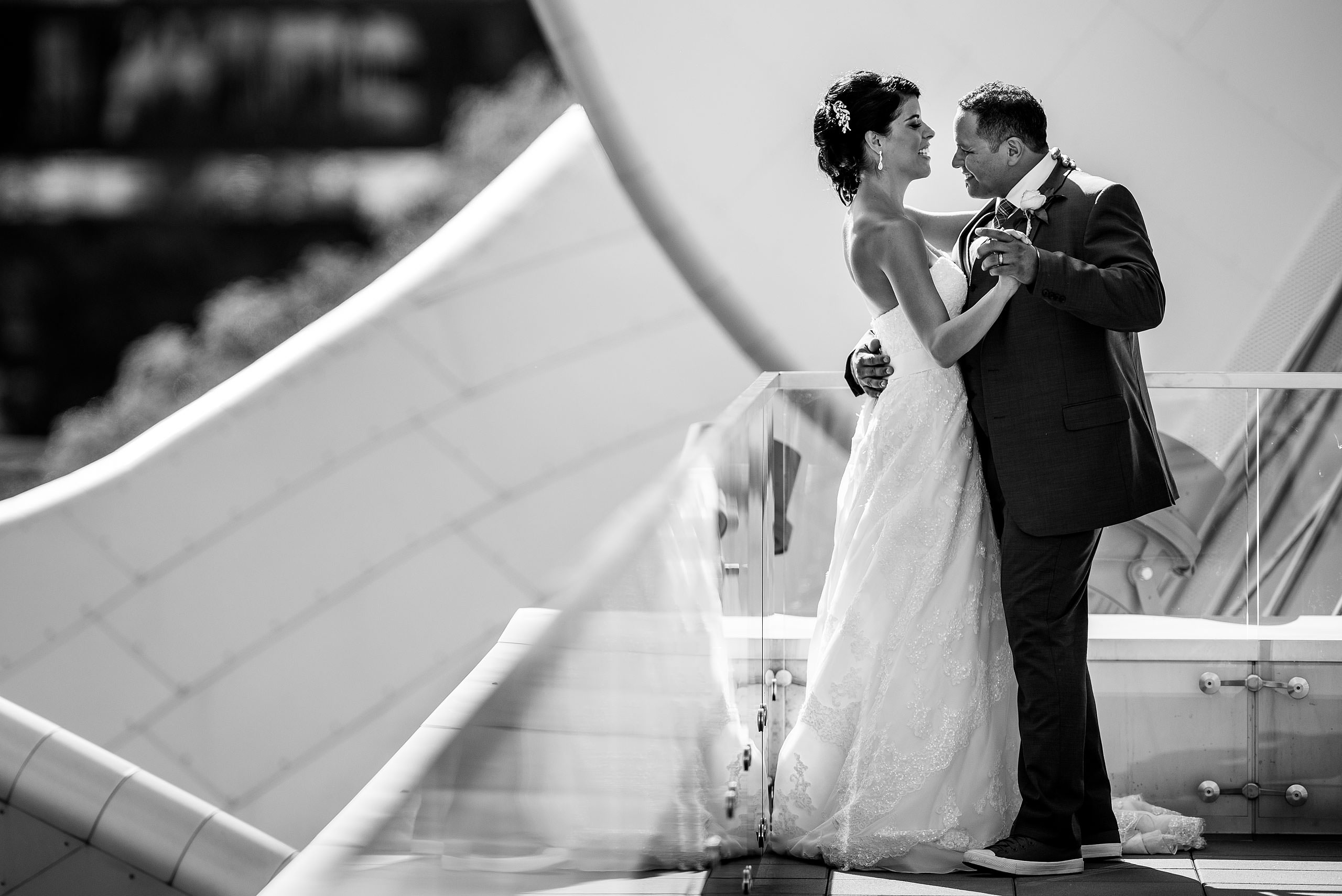 a bride and groom dancing on the roof of the Art Gallery of Alberta by Edmonton wedding photographer sean leblanc