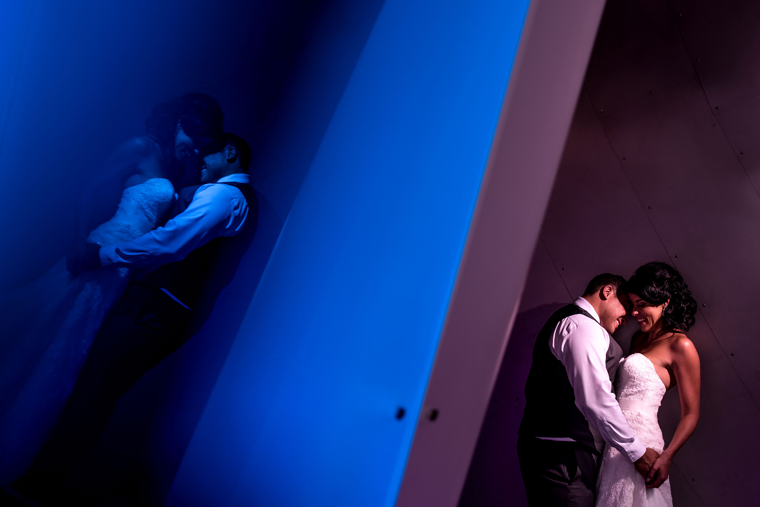 a bride and groom embracing at the Art Gallery of Alberta by Edmonton wedding photographer sean leblanc
