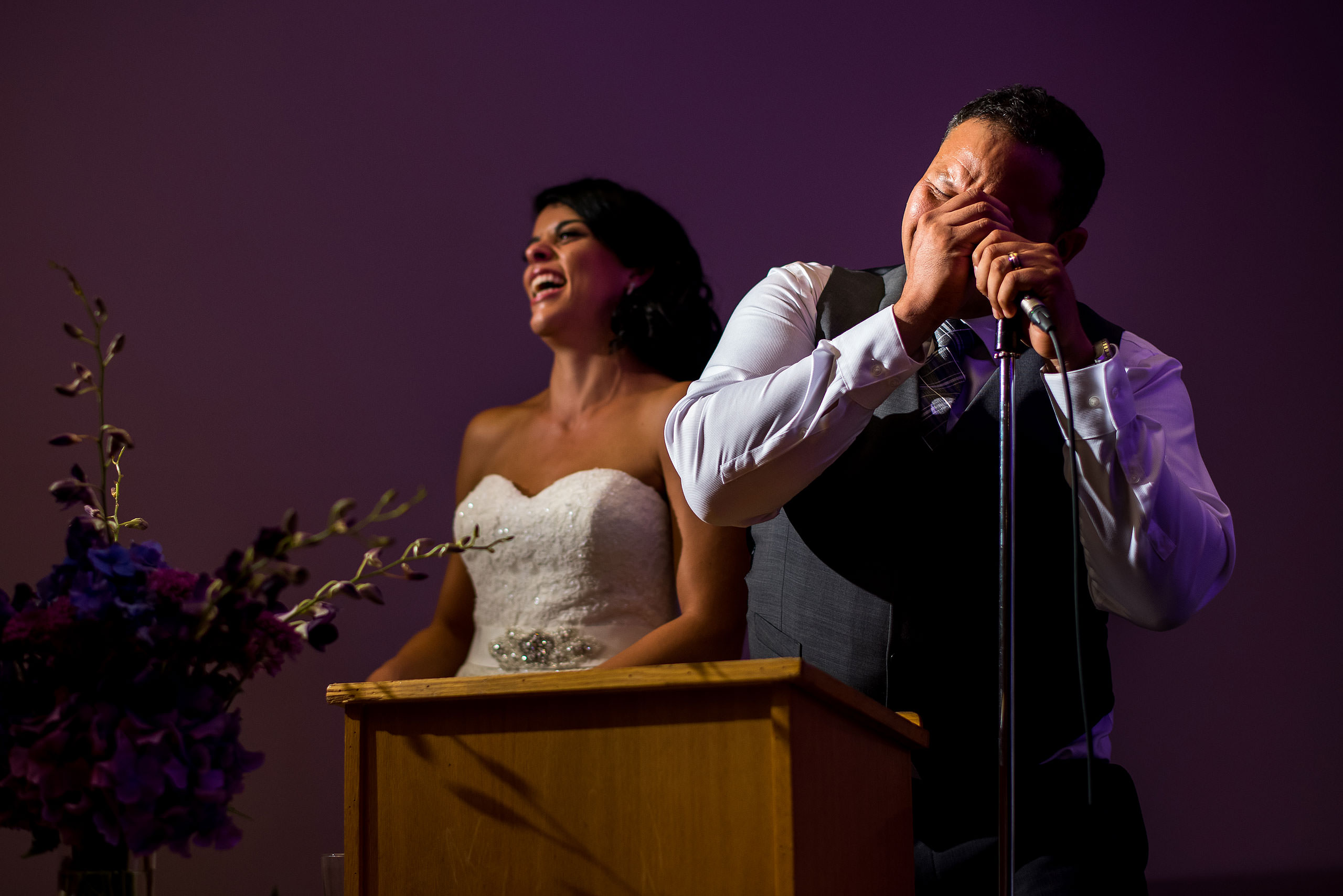 a groom giving a speech with his bride by Edmonton wedding photographer sean leblanc