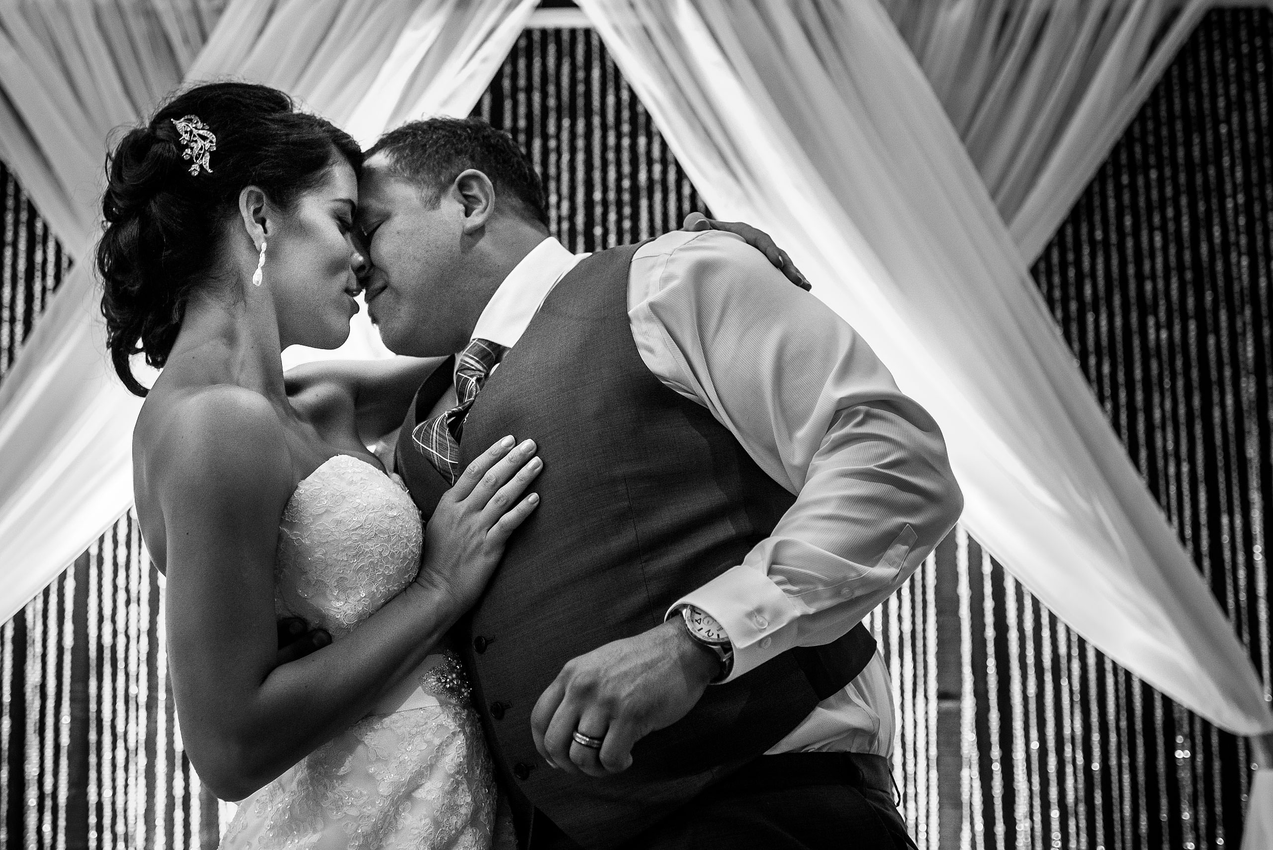 a groom and bride kissing by Edmonton wedding photographer sean leblanc