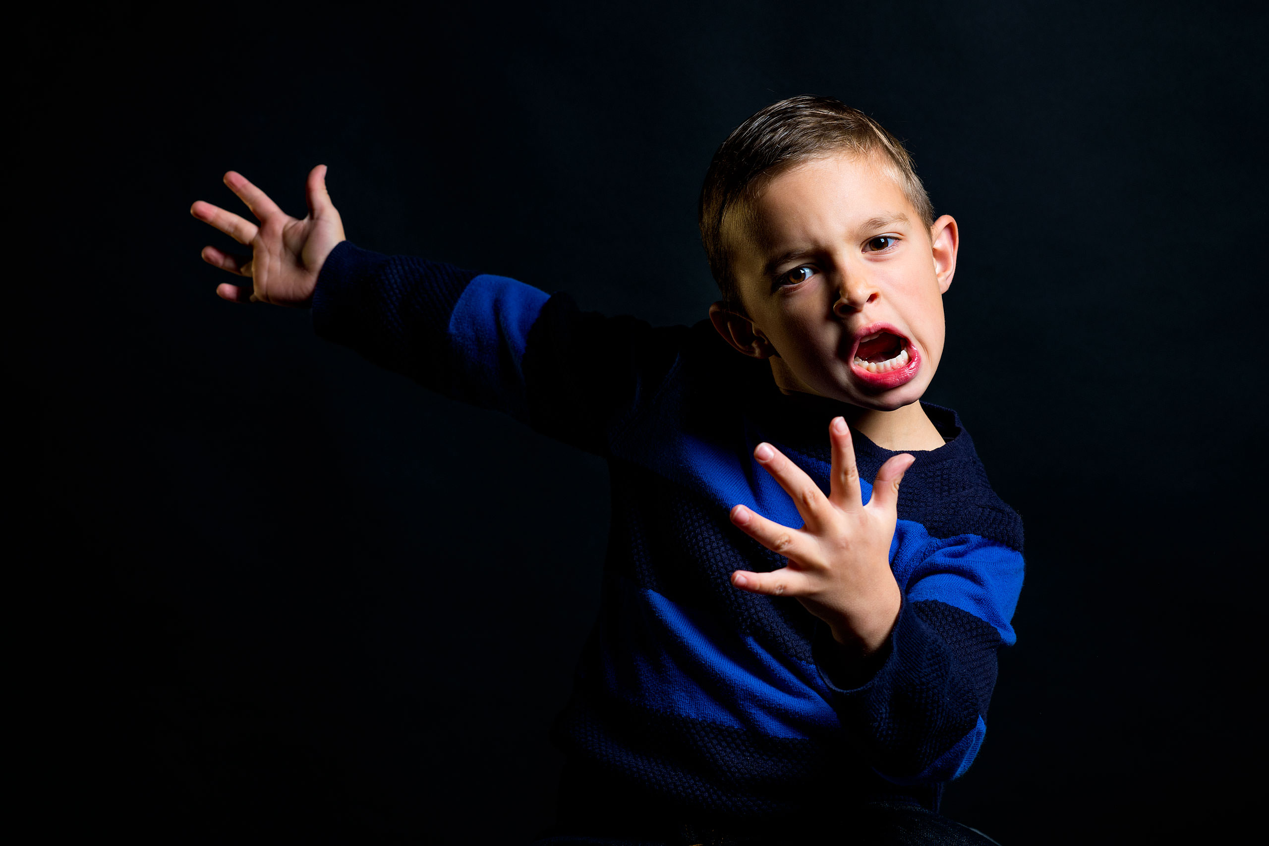 a young boy screaming in a funny manner by top family portrait photographer sean leblanc