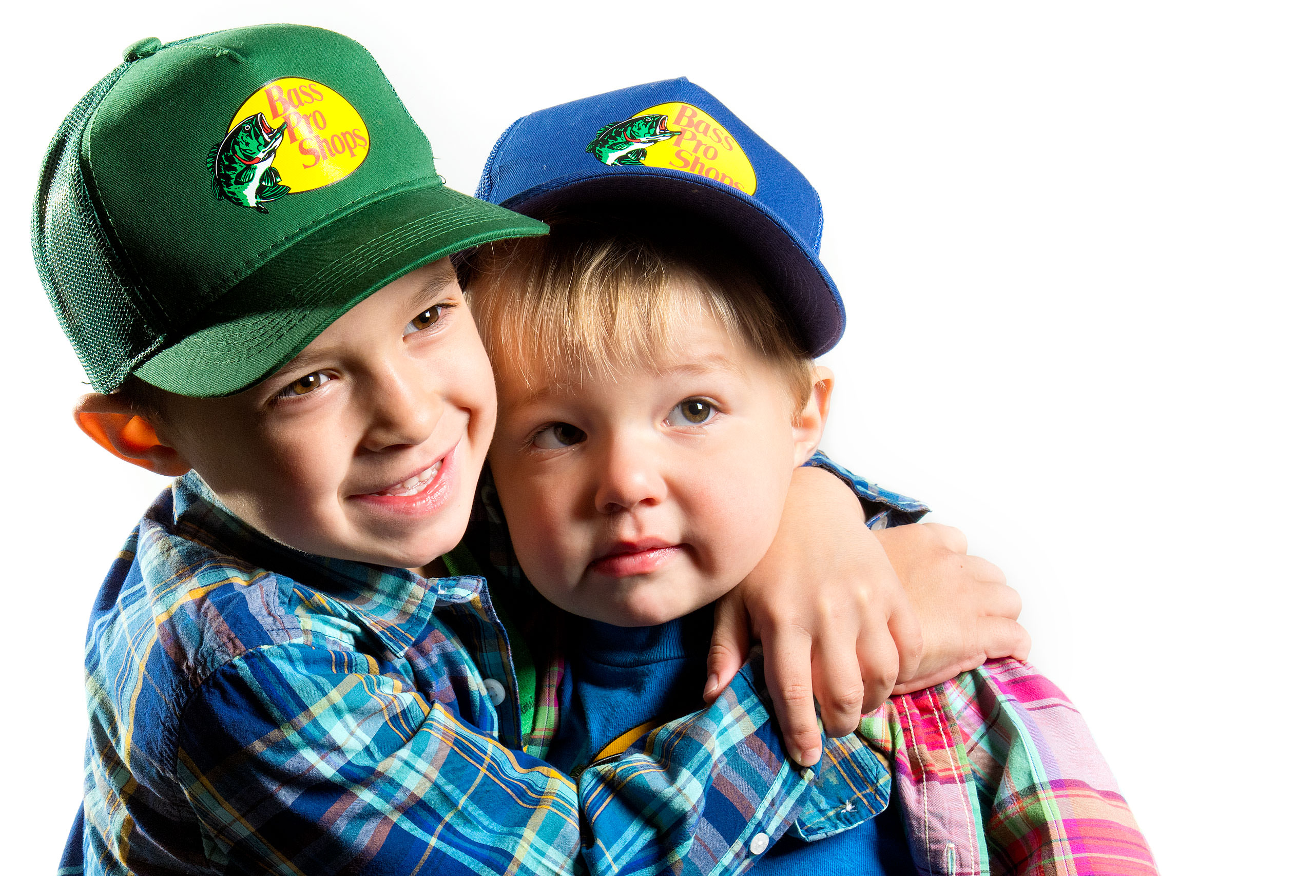 two boys giving each other a big hug for a calgary portrait studio session by sean leblanc