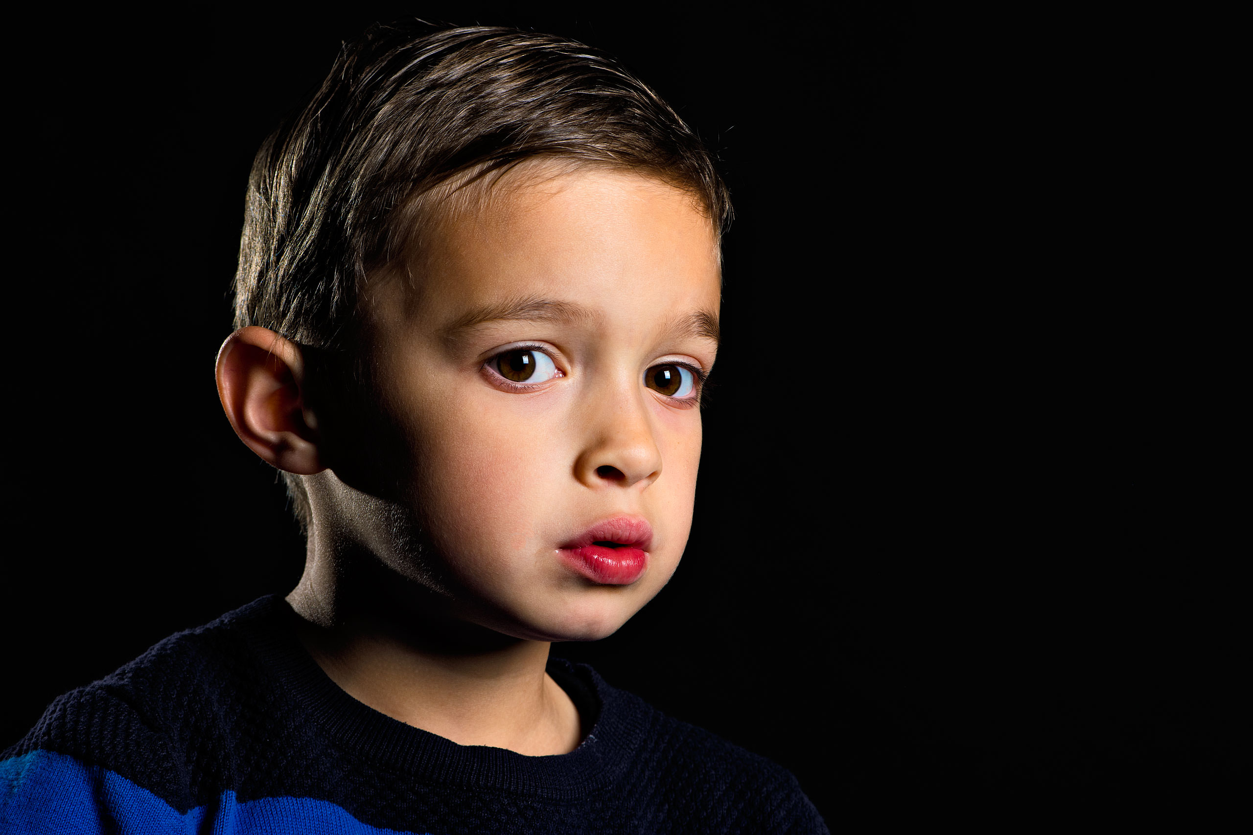 a young boy not smiling for a calgary portrait studio session by sean leblanc