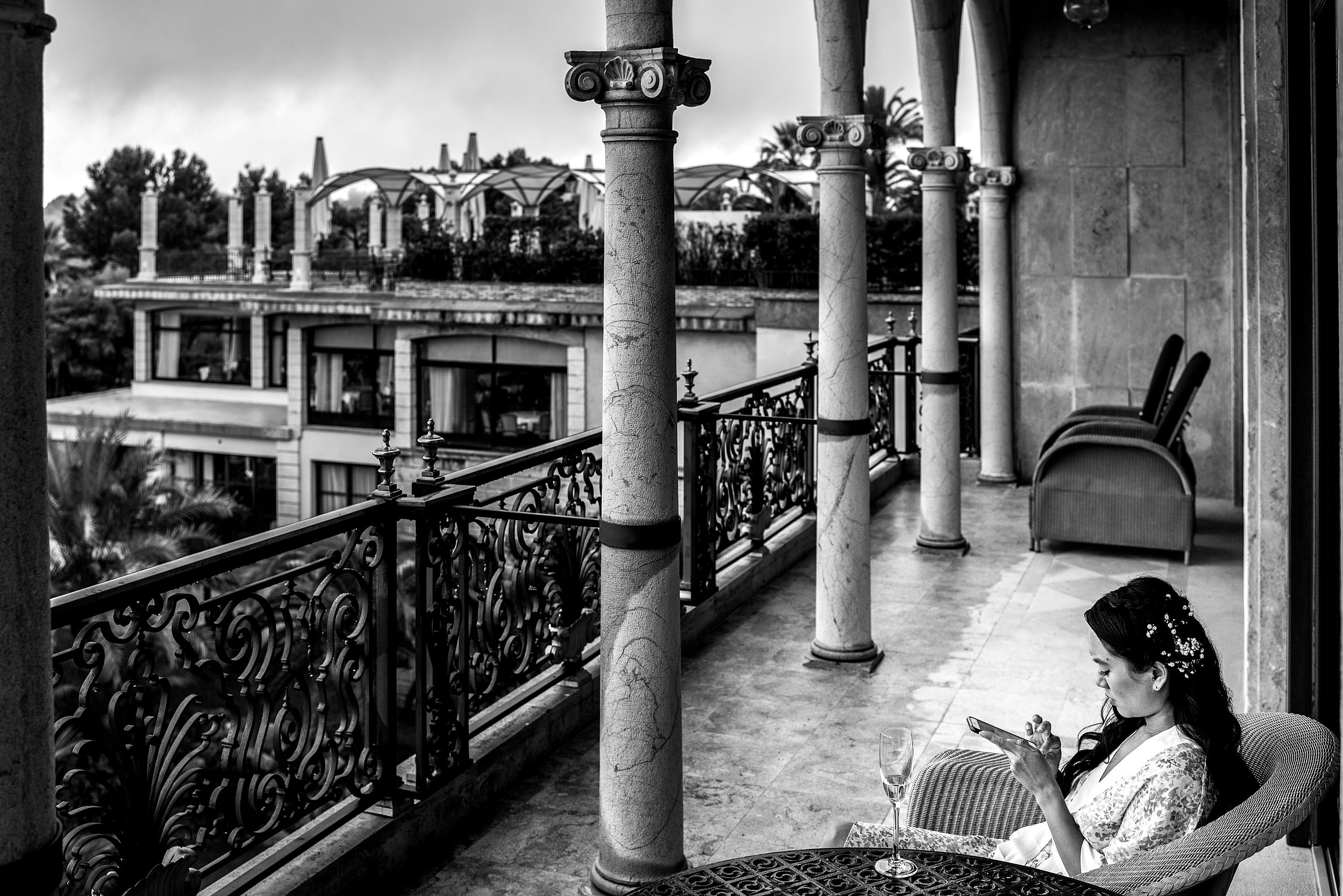 bride sitting on a balcony of a castle hotel at castillo hotel son vida destination wedding by sean leblanc